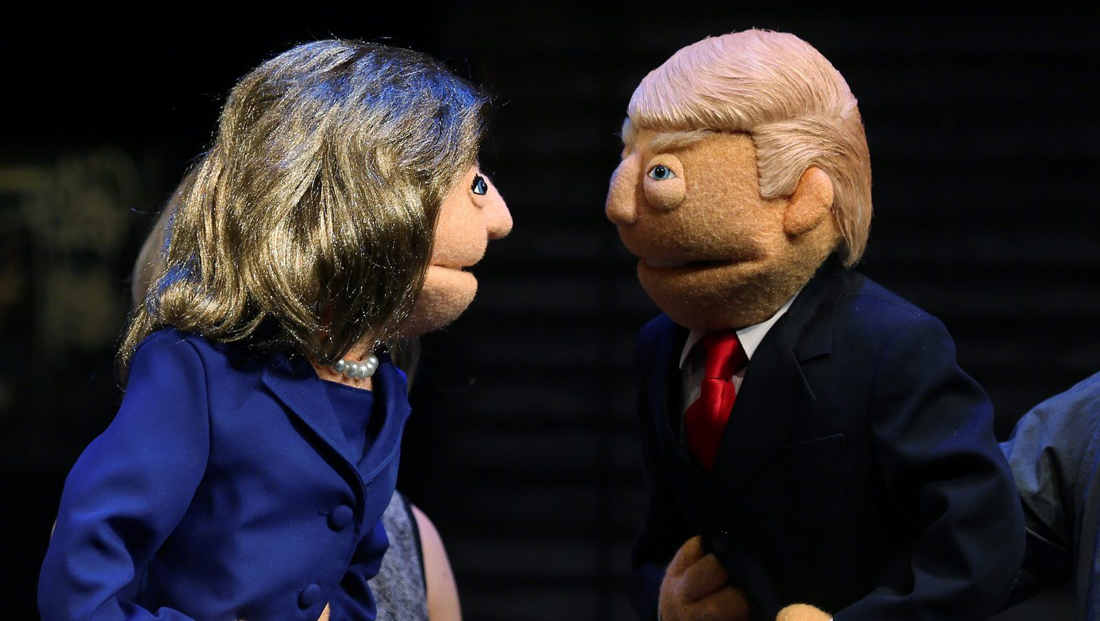 Puppets in the likeness of Democratic presidential nominee Hillary Clinton (L) and Republican presidential nominee Donald Trump (R) face-off as they pose for a photo after a mock Avenue Q sponsored debate in the Manhattan borough of New York, U.S., September 26, 2016. REUTERS/Carlo Allegri - RTSPJ2A