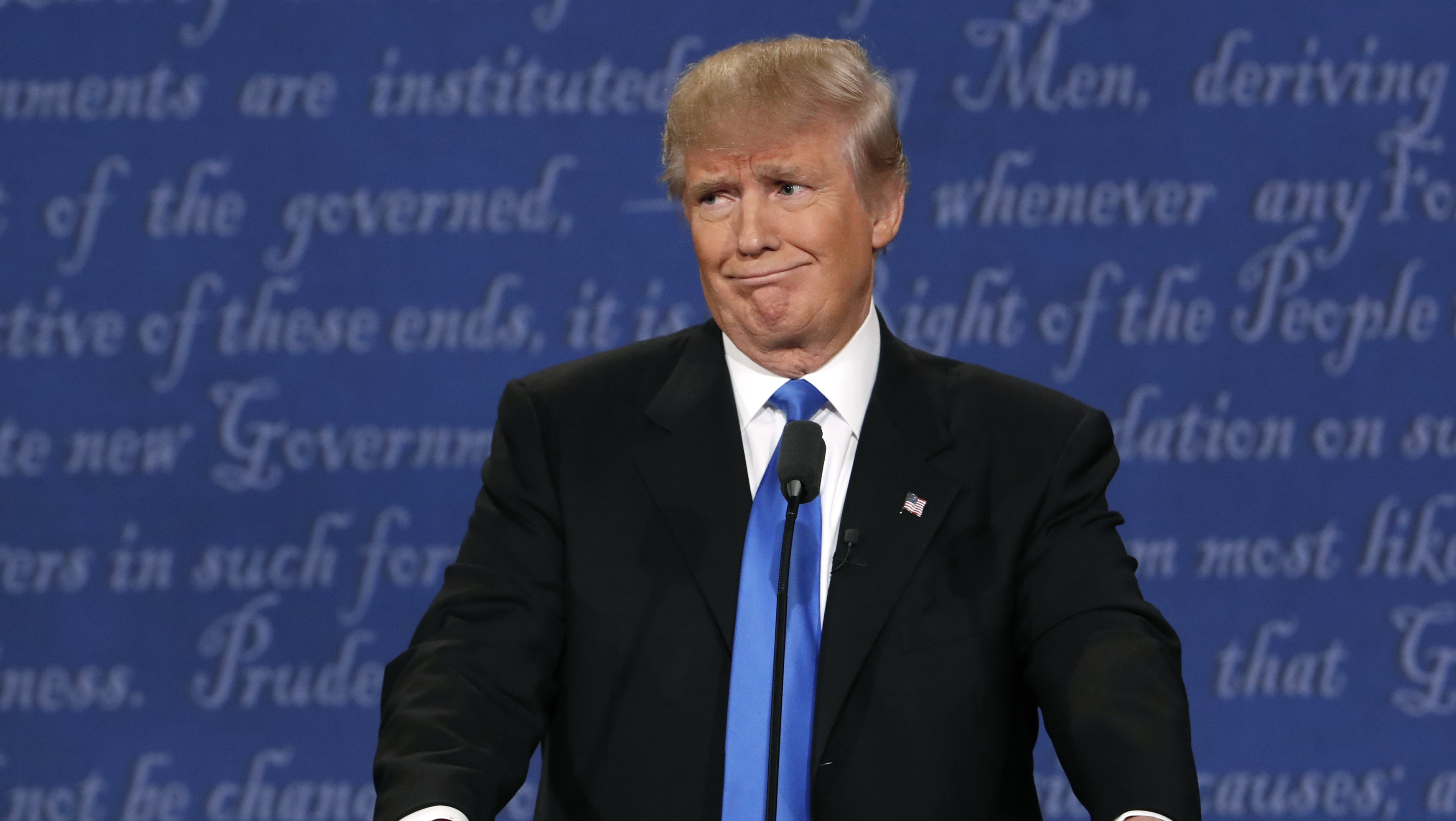 Republican U.S. presidential nominee Donald Trump reacts during the first debate with Democratic U.S. presidential nominee Hillary Clinton at Hofstra University in Hempstead, New York, U.S., September 26, 2016.