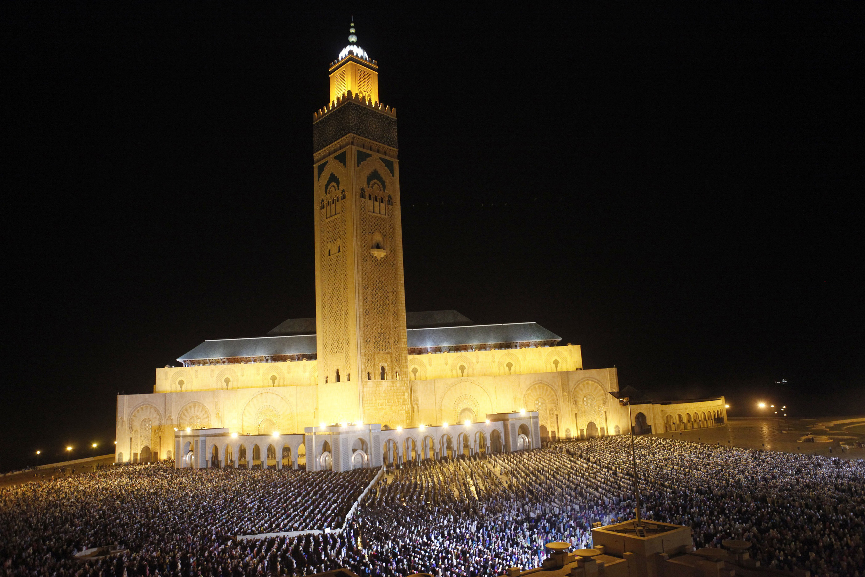 The faithful pray on the esplanade of the Hassan II Mosque in Casablanca, Morocco.