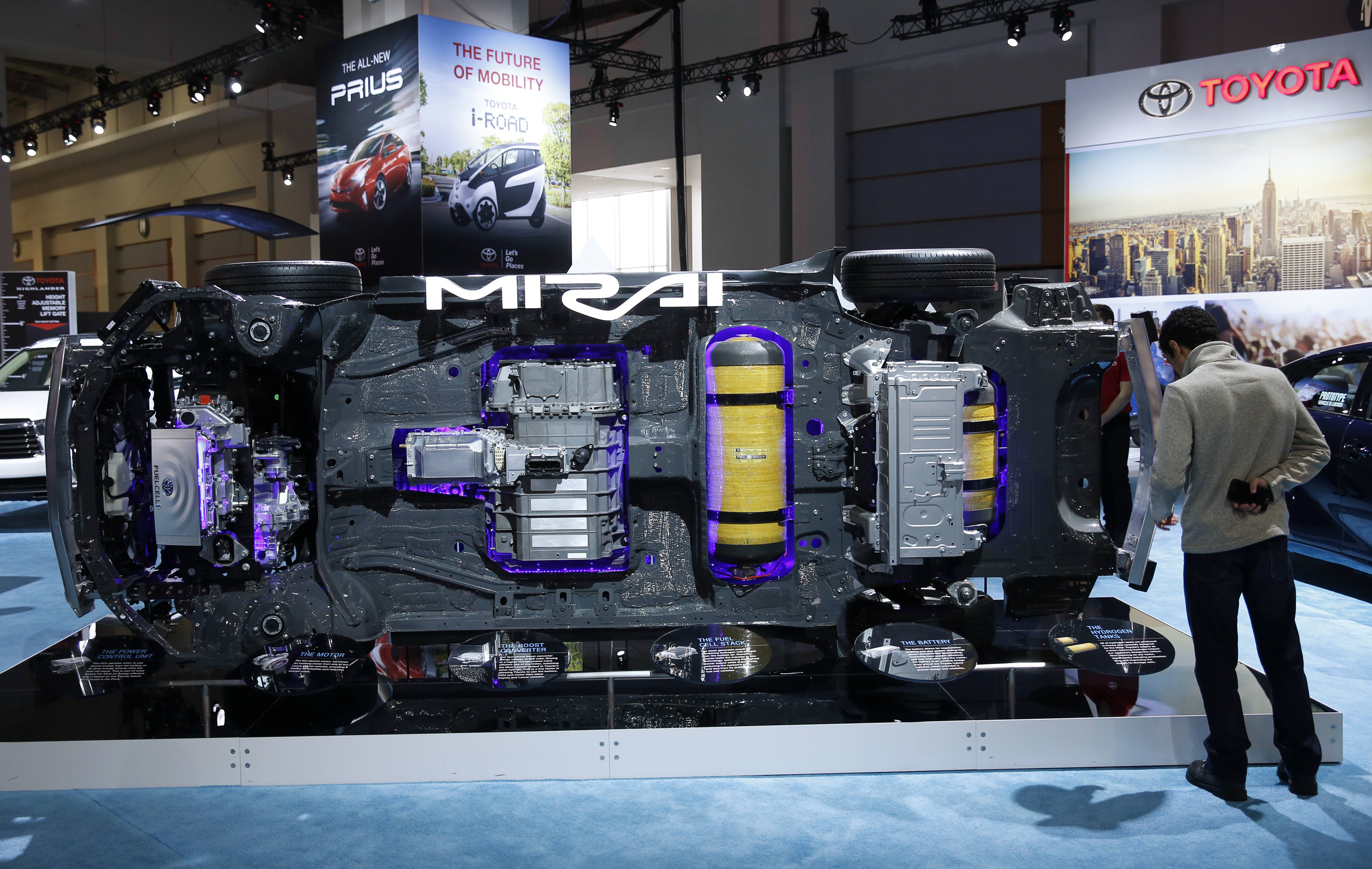 A visitor looks at the underside components of a Toyota Mirai hydrogen fuel cell vehicle at the Washington Auto Show in Washington January 29, 2016.