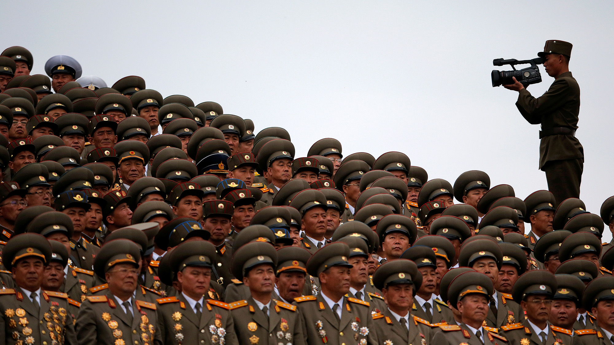 A solider films military officers following a mass dance performance in the capital's main ceremonial square, a day after the ruling Workers' Party of Korea party wrapped up its first congress in 36 years, in Pyongyang, North Korea, May 10, 2016. REUTERS/Damir Sagolj     TPX IMAGES OF THE DAY      - RTX2DOF8