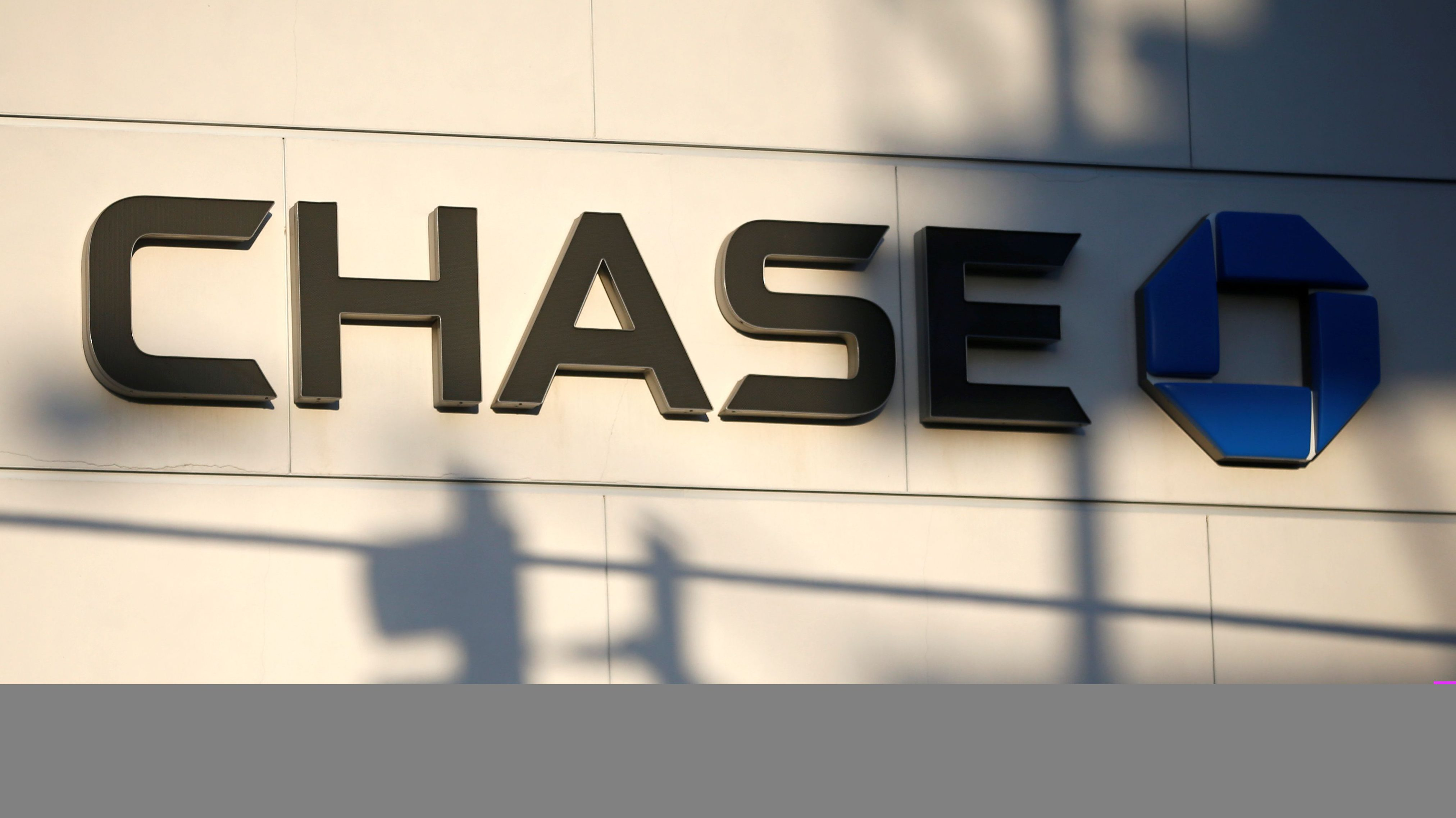 The logo of Dow Jones Industrial Average stock market index listed company Chase (JPM) is seen in Los Angeles, California, United States, April 25, 2016. Picture taken April 25, 2016. JPMorgan Chase & Co. owns Chase Commerical Bank and JPMorgan Investment Bank.  REUTERS/Lucy Nicholson - RTX2E4AC