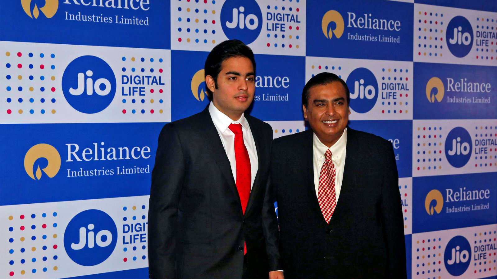 Mukesh Ambani (R), chairman of Reliance Industries Ltd, poses with his son Akash before addressing the company's annual general meeting in Mumbai, India September 1, 2016.