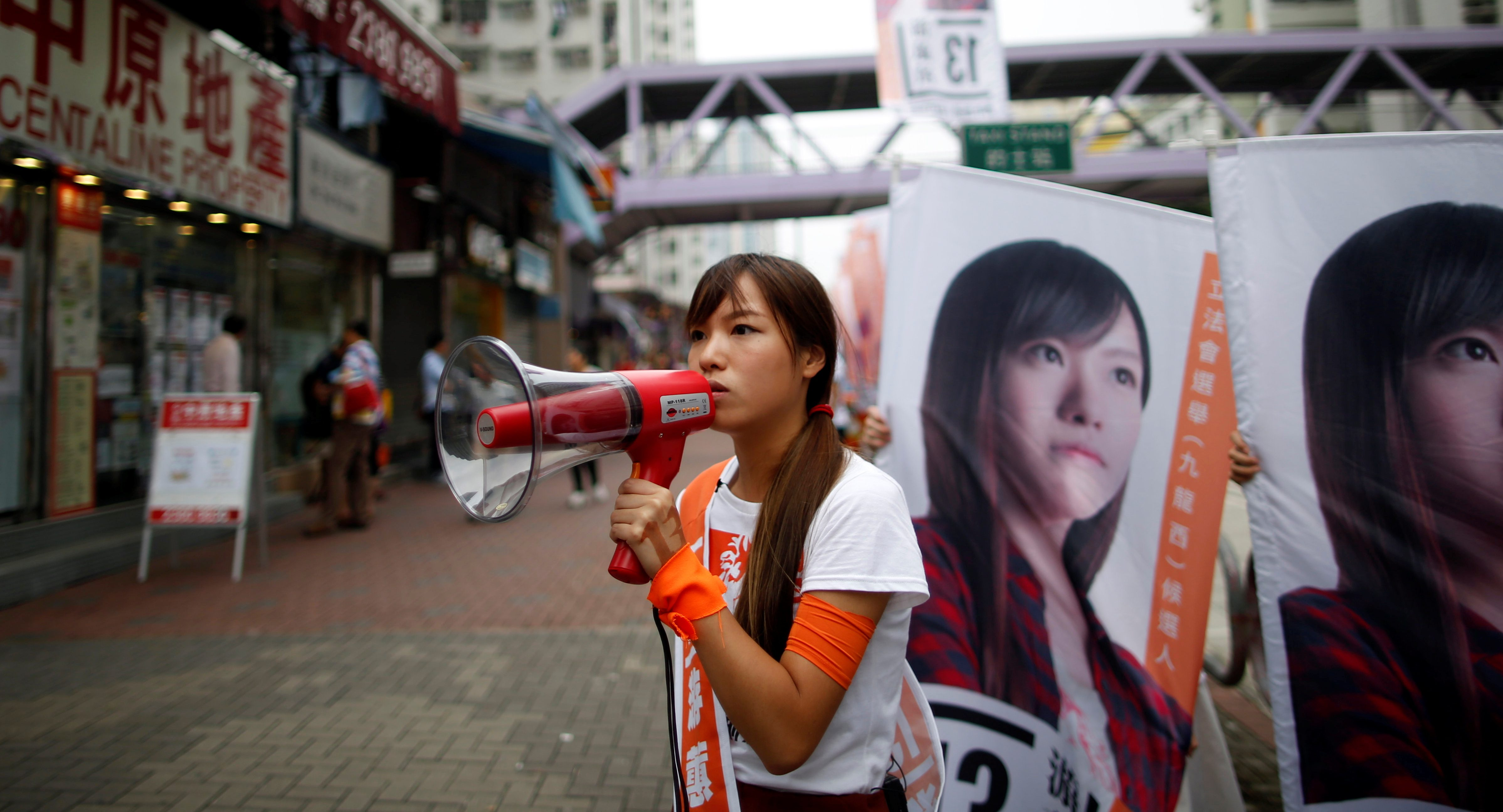 Candidate Yau Wai-ching, member of political group Youngspiration, campaigns on the election day of the Legislative Council in Hong Kong