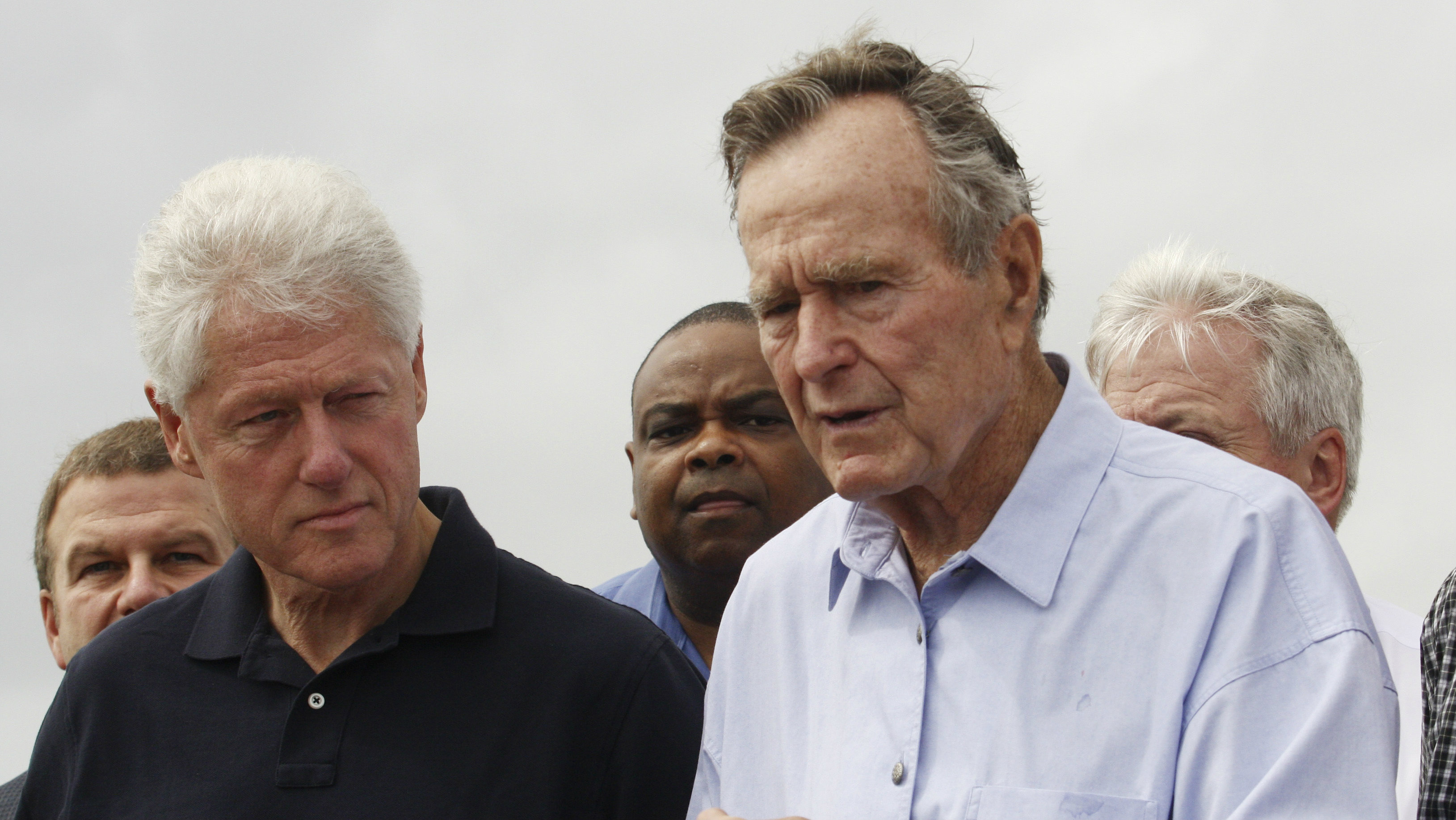 Former U.S. Presidents Bush and Clinton speak after the pair looked at damage from Hurricane Ike on the...