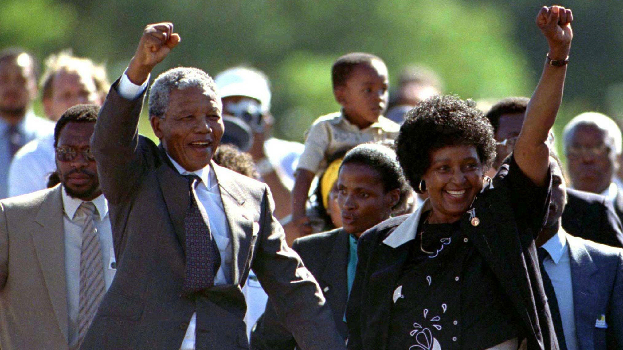 Nelson Mandela (front L), accompanied by his wife Winnie, walks out of the Victor Verster prison, near Cape Town, after spending 27 years in apartheid jails on February 11, 1990. REUTERS/Ulli Michel - RTR144Z