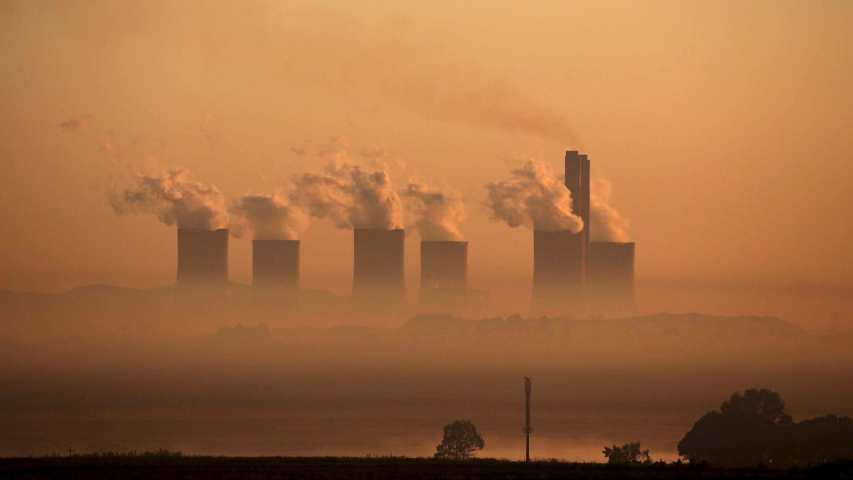 Steam rises at sunrise from the Lethabo Thermal Power Station, an Eskom coal-burning power station  near Sasolburg in the northern Free State province, March 2, 2016. South Africa's energy regulator said on Tuesday it had allowed state-owned power firm Eskom to raise tariffs by 9.4 percent in the 2016/17, less than what had been requested by the cash-strapped utility.