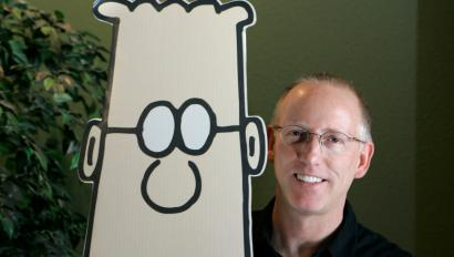 Scott Adams, creator of the comic strip Dilbert, poses for a portrait with the Dilbert character in his studio in Dublin, Calif., Thursday, Oct. 26, 2006. Adams, 49, appears to be a rare example of someone who has largely but not totally, recovered from Spasmodic Dysphonia, a mysterious disease in which parts of the brain controlling speech shut down or go haywire. As many as 30,000 Americans are afflicted, typically in their 40s and 50s, experts say. (AP Photo/Marcio Jose Sanchez)