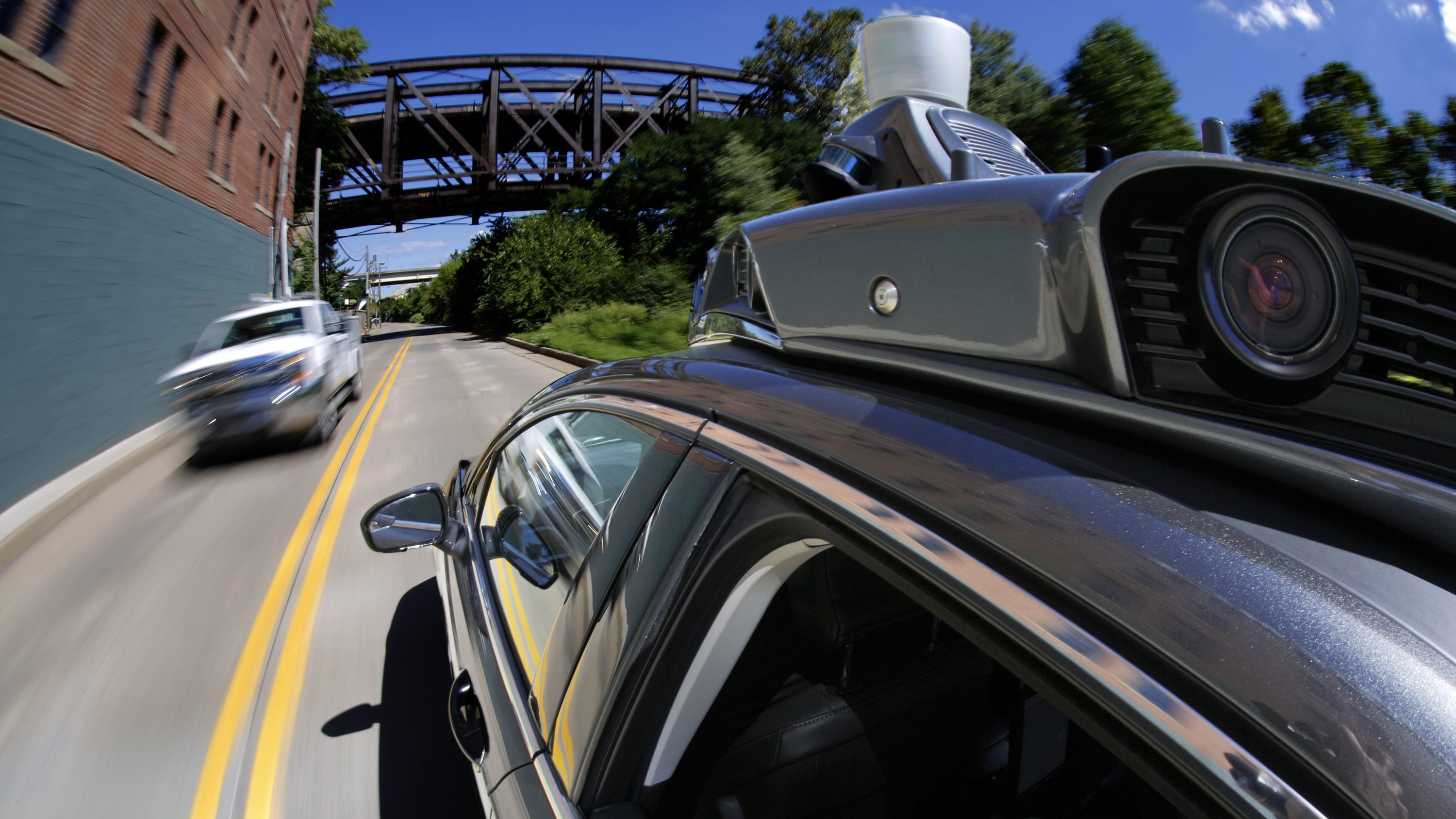 In this Monday, Sept. 12, 2016, photo, a self-driving Uber drives in Pittsburgh during a media preview. Starting Wednesday, Sept. 14, 2016, dozens of self-driving Ford Fusions will pick up riders who opted into a test program with Uber. While the vehicles are loaded with features that allow them to navigate on their own, an Uber engineer will sit in the driver's seat and seize control if things go awry. (AP Photo/Gene J. Puskar)