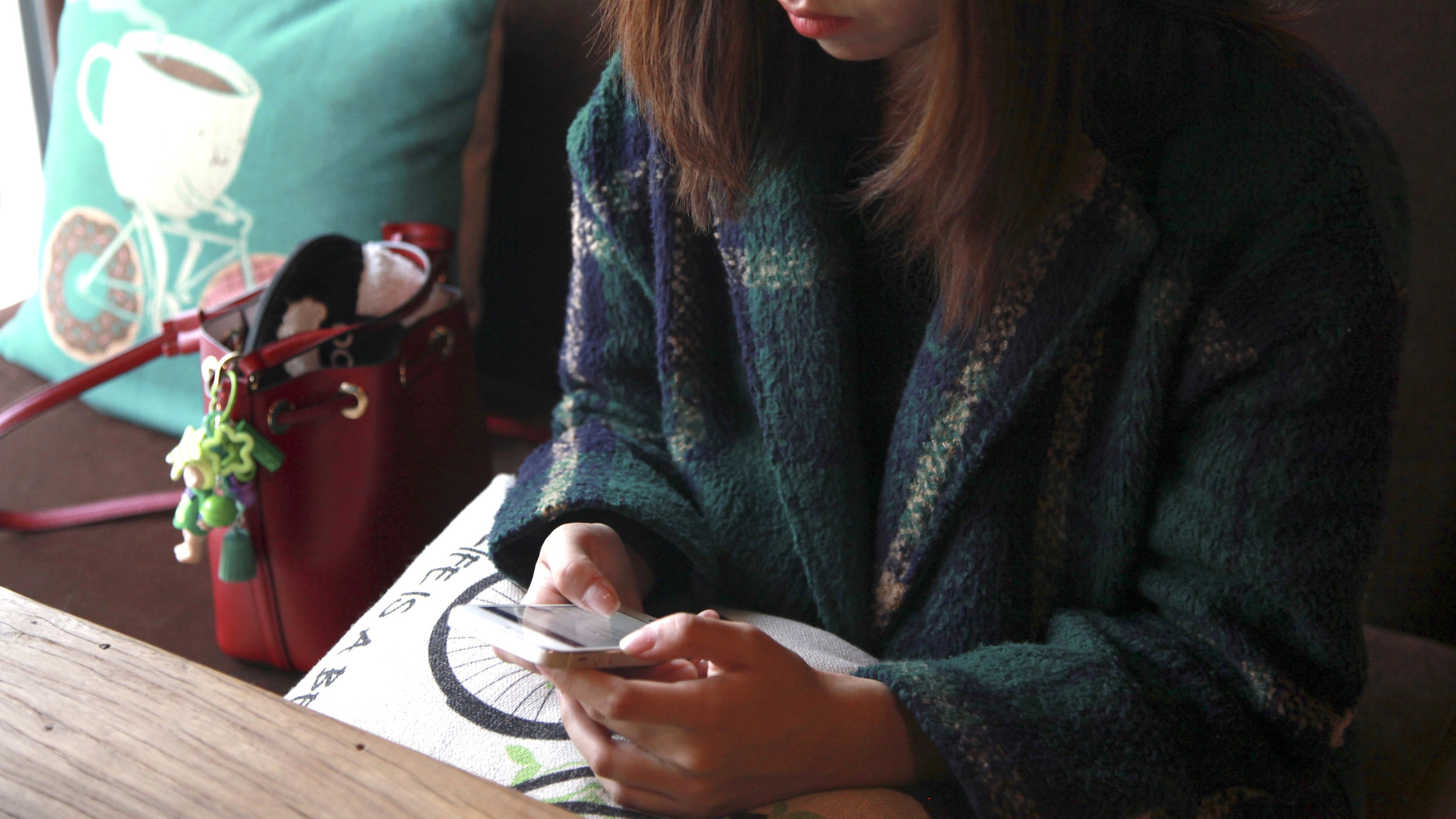 A woman uses an app on a mobile phone