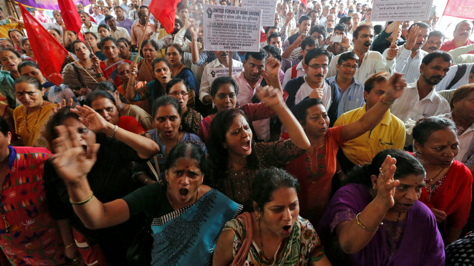 Bank employees shout slogans as they attend a strike opposing the government's proposal to merge SBI's (State Bank of India) associate banks with SBI, and against the government's proposed move to privatise IDBI Bank, in Mumbai, India, July 29, 2016.