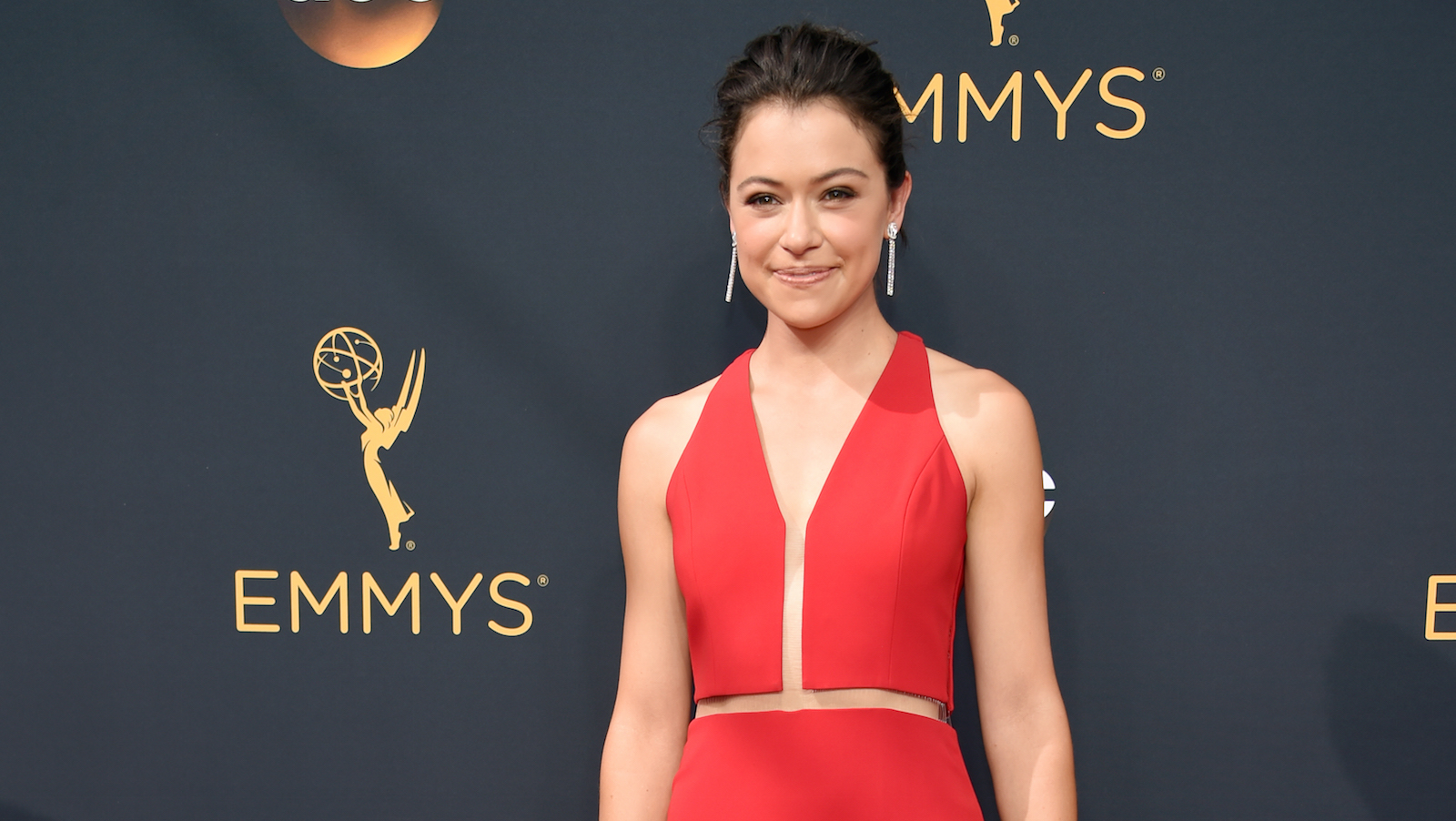 Tatiana Maslany  arrives at the 68th Primetime Emmy Awards on Sunday, Sept. 18, 2016, at the Microsoft Theater in Los Angeles. (Photo by Phil McCarten/Invision for the Television Academy/AP Images)