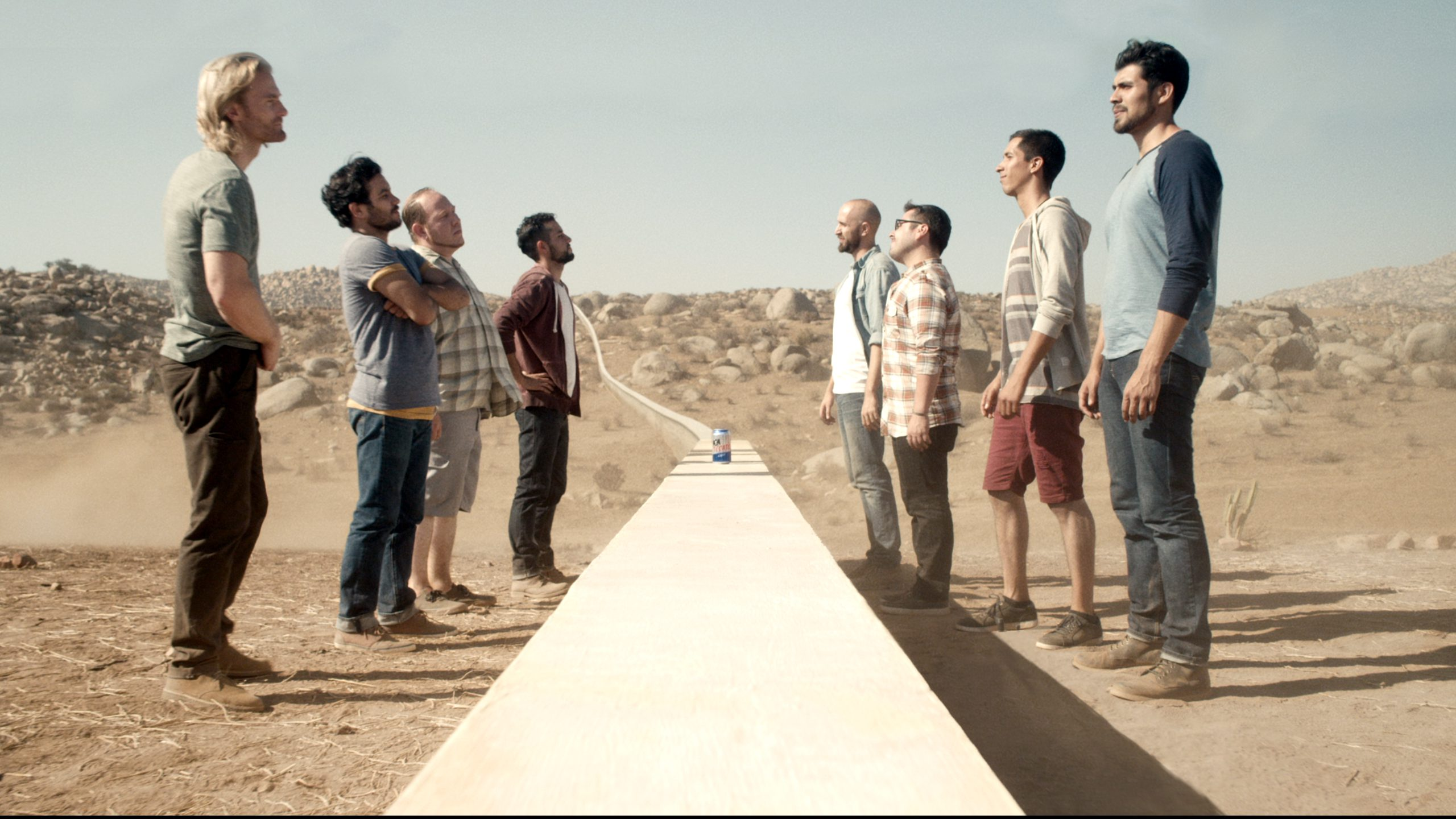 A scene from a Tecate beer TV ad that shows an encounter between beer drinkers in the US and Mexico.
