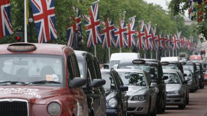 Cars queue up the Mall, London.