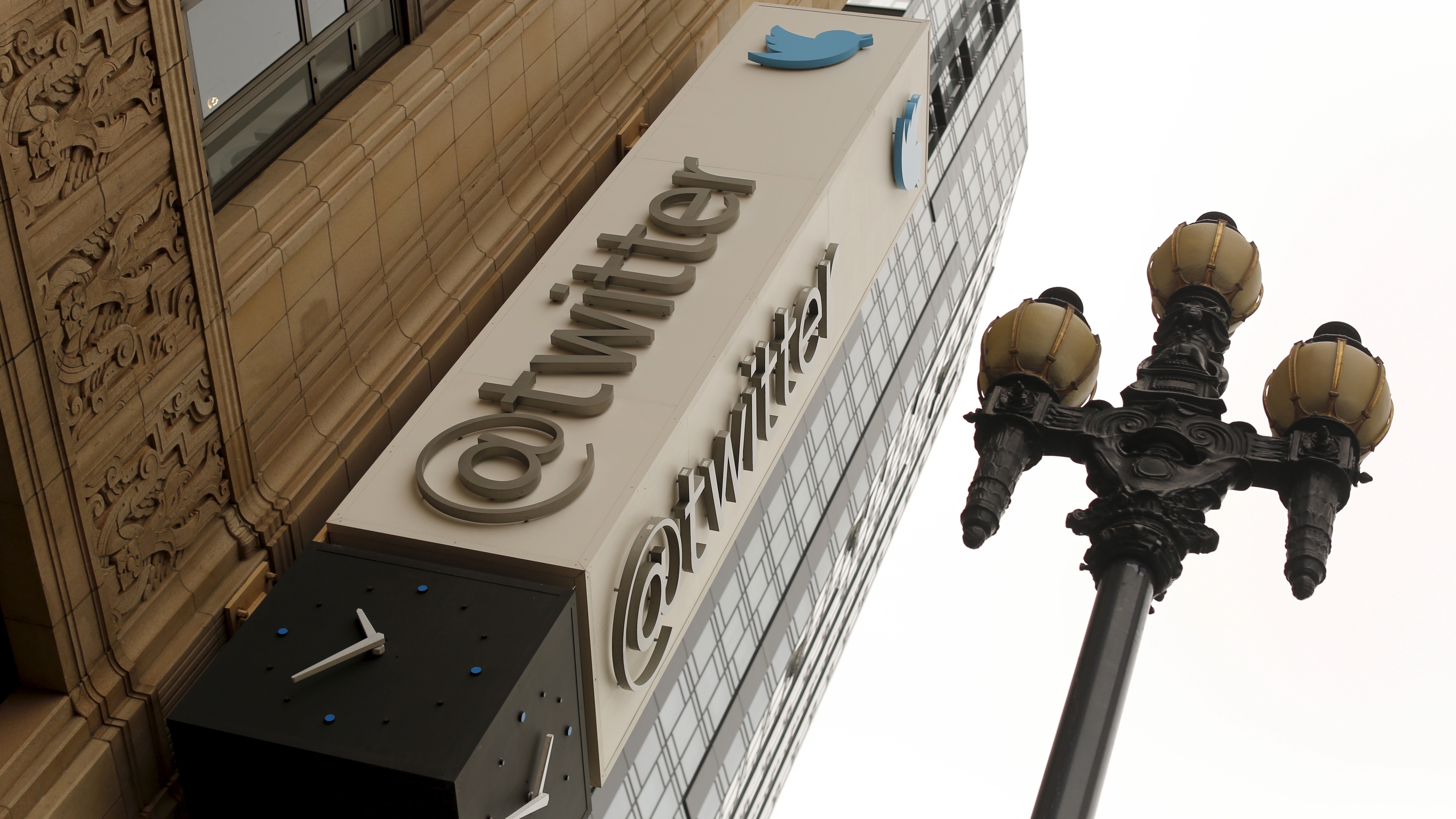 The Twitter logo is shown at its corporate headquarters  in San Francisco, California April 28, 2015. Twitter Inc. cut its full-year revenue forecast due to weak demand for its direct response products, sending its shares down as much as 24 percent on Tuesday.Twitter said it expected 2015 revenue of $2.17 billion to$2.27 billion, compared with an earlier forecast of $2.3 billion to $2.35 billion. Analysts on average had been expecting full-year revenue of $2.37 billion. REUTERS/Robert Galbraith - RTX1APZE