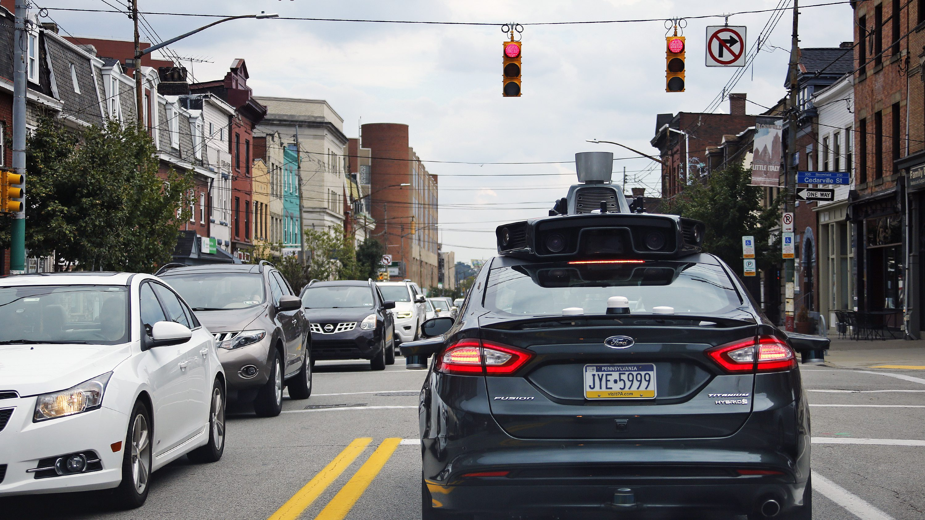A self driving Uber car drives on Liberty Ave. through the Bloomfield neighborhood of Pittsburgh.
