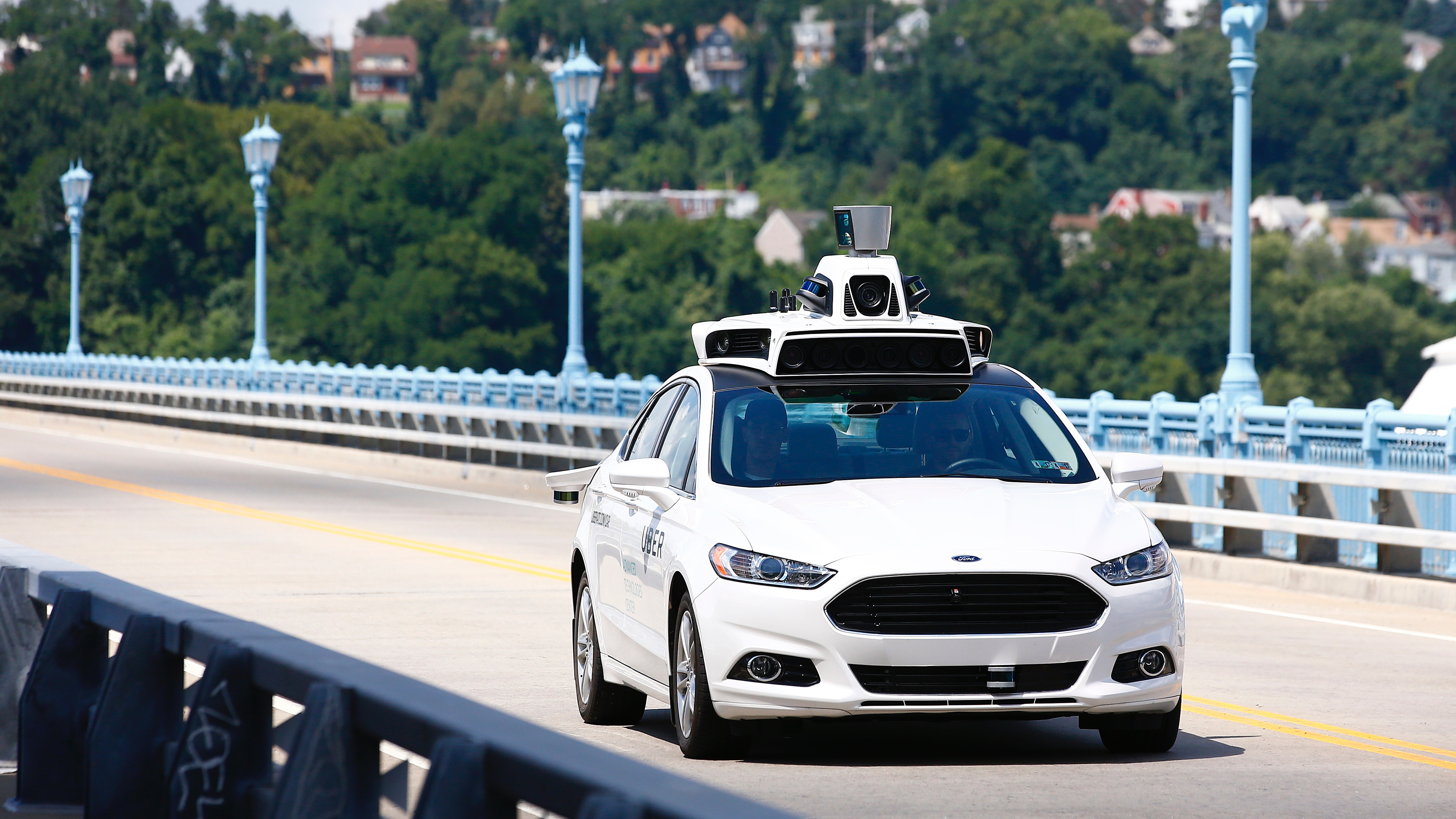 Uber employees test the self-driving Ford Fusion hybrid cars in Pittsburgh, Pa on Thursday, Aug. 18, 2016. (AP Photo/Jared Wickerham)