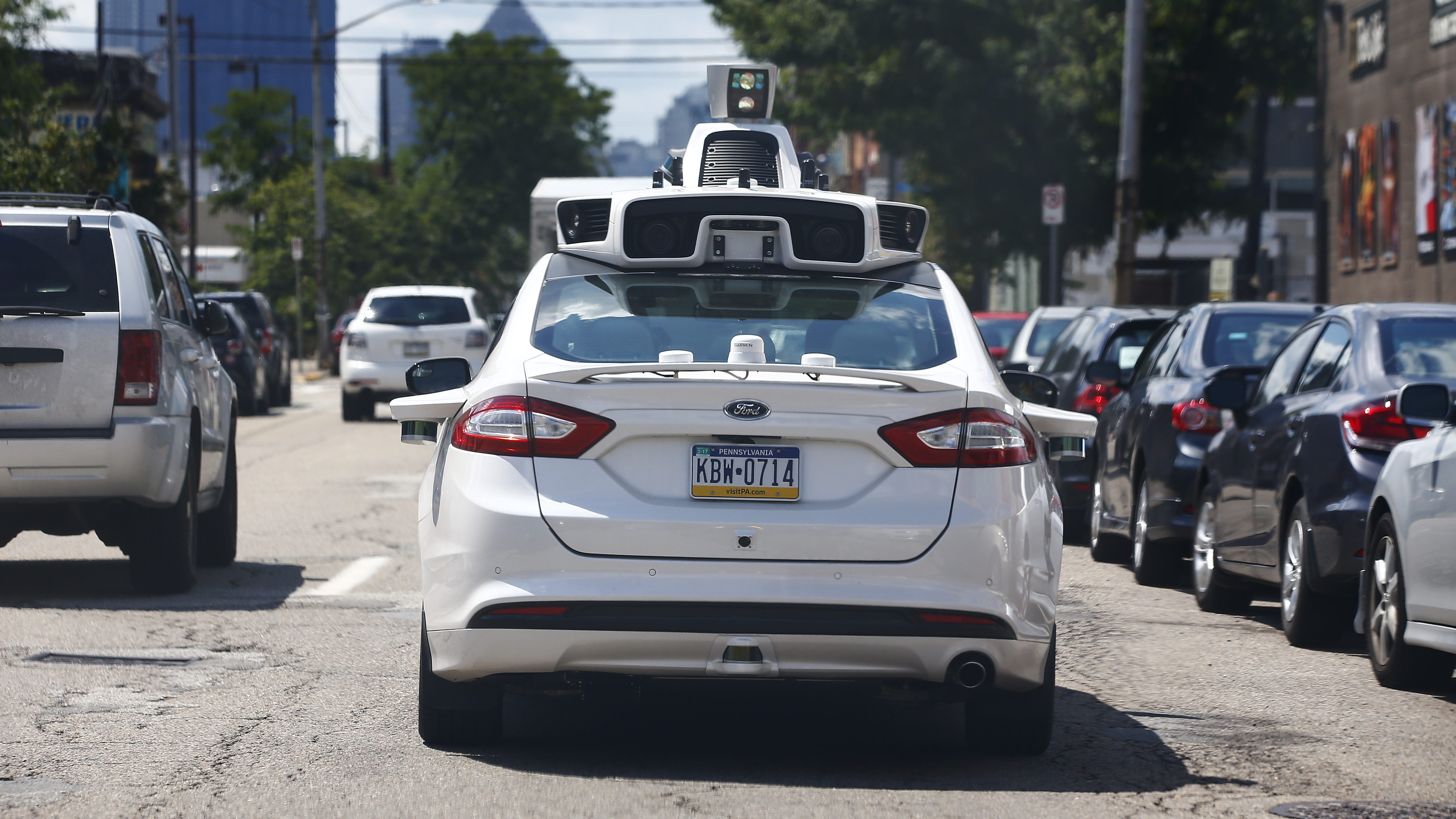 A self-driving Ford Fusion hybrid car is test driven, Thursday, Aug. 18, 2016, in Pittsburgh. Uber said that passengers in Pittsburgh will be able to summon rides in self-driving cars with the touch of a smartphone button in the next several weeks. The high-tech ride-hailing company said that an unspecified number of autonomous Ford Fusions with human backup drivers will pick up passengers just like normal Uber vehicles. Riders will be able to opt in if they want a self-driving car, and rides will be free to those willing to do it, spokesman Matt Kallman said. (AP Photo/Jared Wickerham)