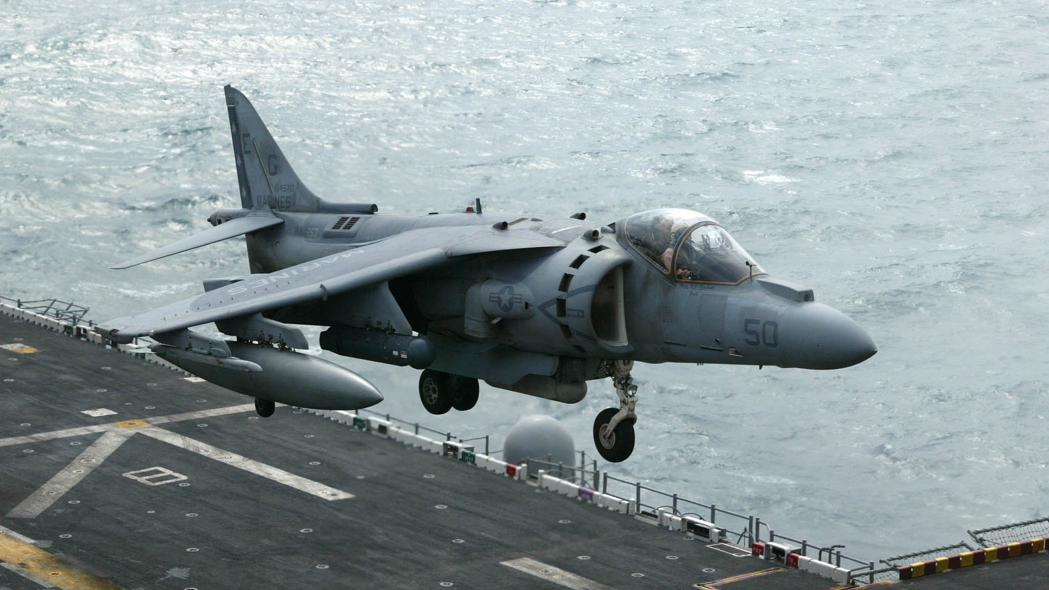 A Marine AV-8BII+ Harrier jump jet hovers at it prepares to land on the flight deck of the USS Nassau (LHA-4) in the Gulf, January 28, 2003. The USS Nassau is the main ship in an Amphibious Ready Group which includes the USS Austin and the USS Tortuga, all which transport 2,200 Marines, members of the 24th Marine Expeditionary Unit (MEU), operating in support of Operation Enduring Freedom. REUTERS/John Schults REUTERS  JES/FMS - RTRHCOS