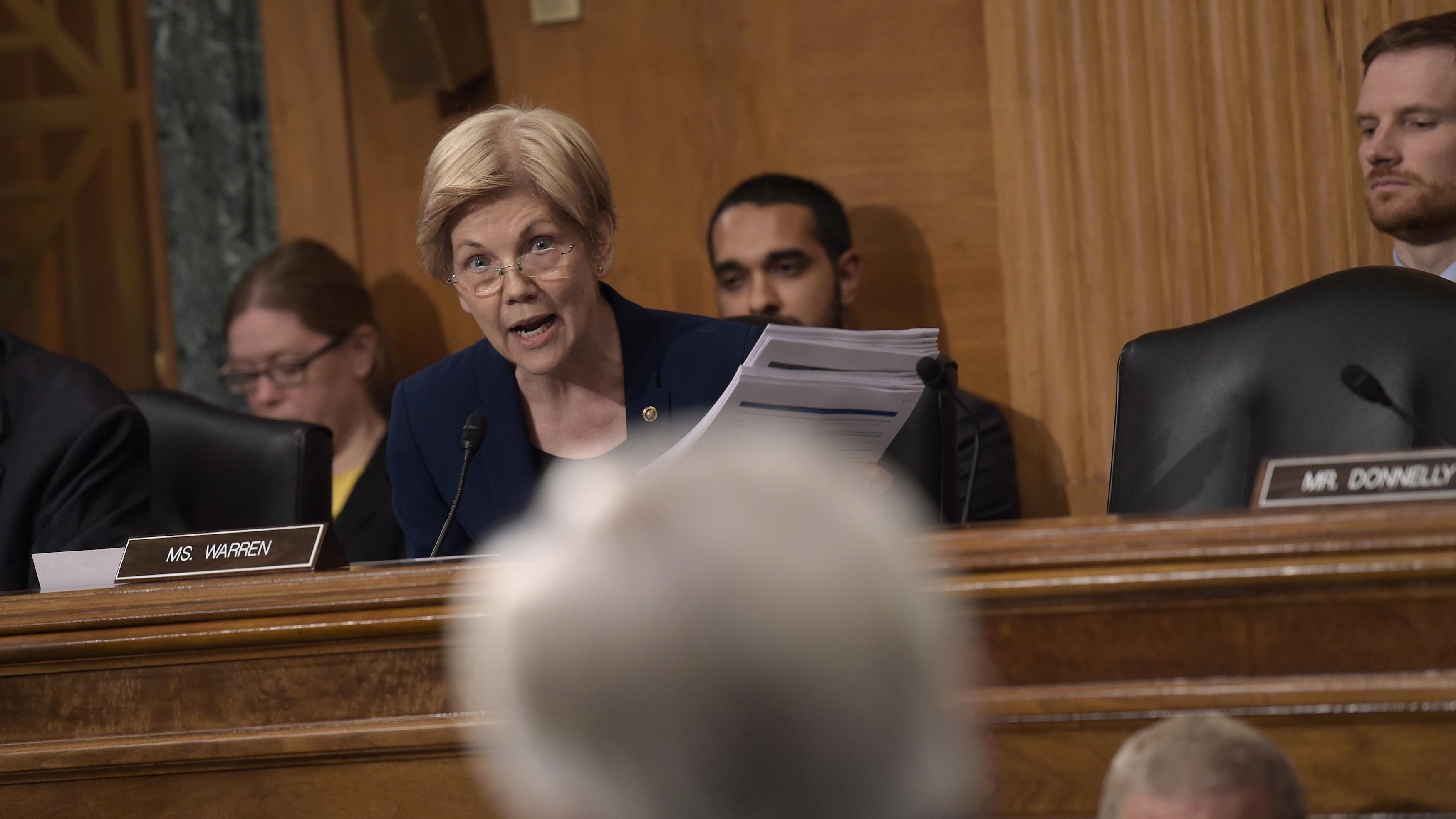 Senator Warren addresses Wells Fargo CEO John Stumpf during a hearing for the Senate Banking Committee in Washington, DC.