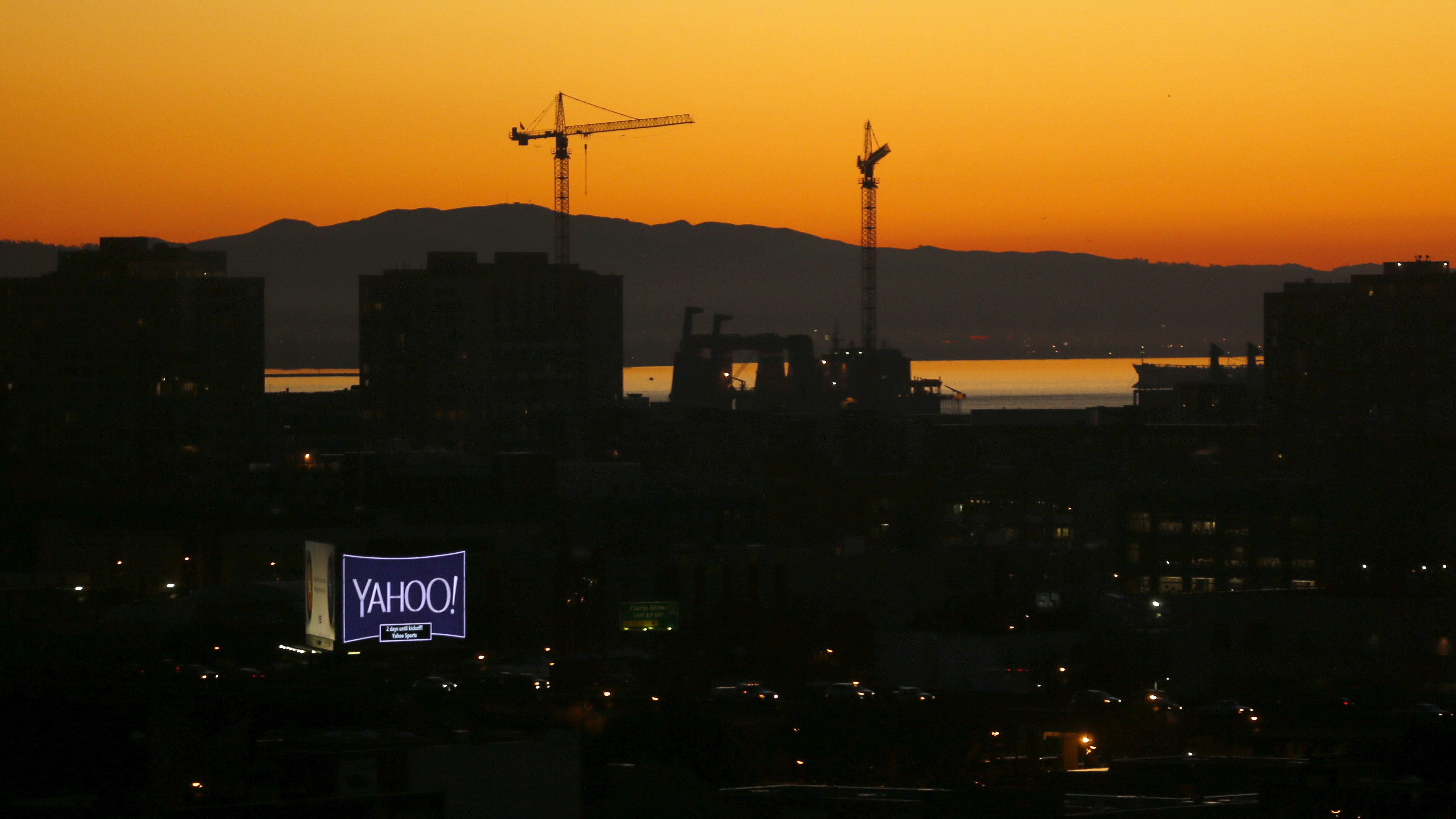 A sign advertising the internet company Yahoo is pictured at sun rise in down town San Francisco