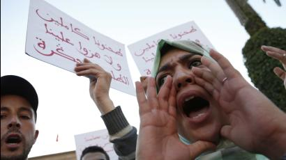 """A Moroccan shouts as thousands of Moroccans protest against the death of Mouhcine Fikri last Friday, with placard reading """"mash us of respect us"""", in the northern city of Hoceima in Rabat, Morocco, Sunday, Oct. 30, 2016. Crowds of Moroccans are protesting, seemingly incensed by the death of a fisherman crushed to death in a garbage truck."""