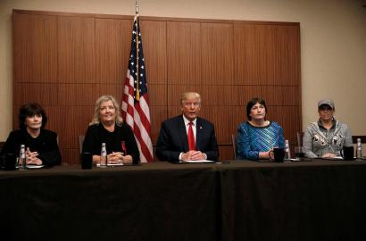 Republican presidential nominee Donald Trump sits with (from R-L) Paula Jones, Kathy Shelton, Juanita Broaddrick, Kathleen Willey in a hotel conference room in St. Louis, Missouri, U.S., shortly before the second presidential debate at Washington University in St. Louis, October 9, 2016.