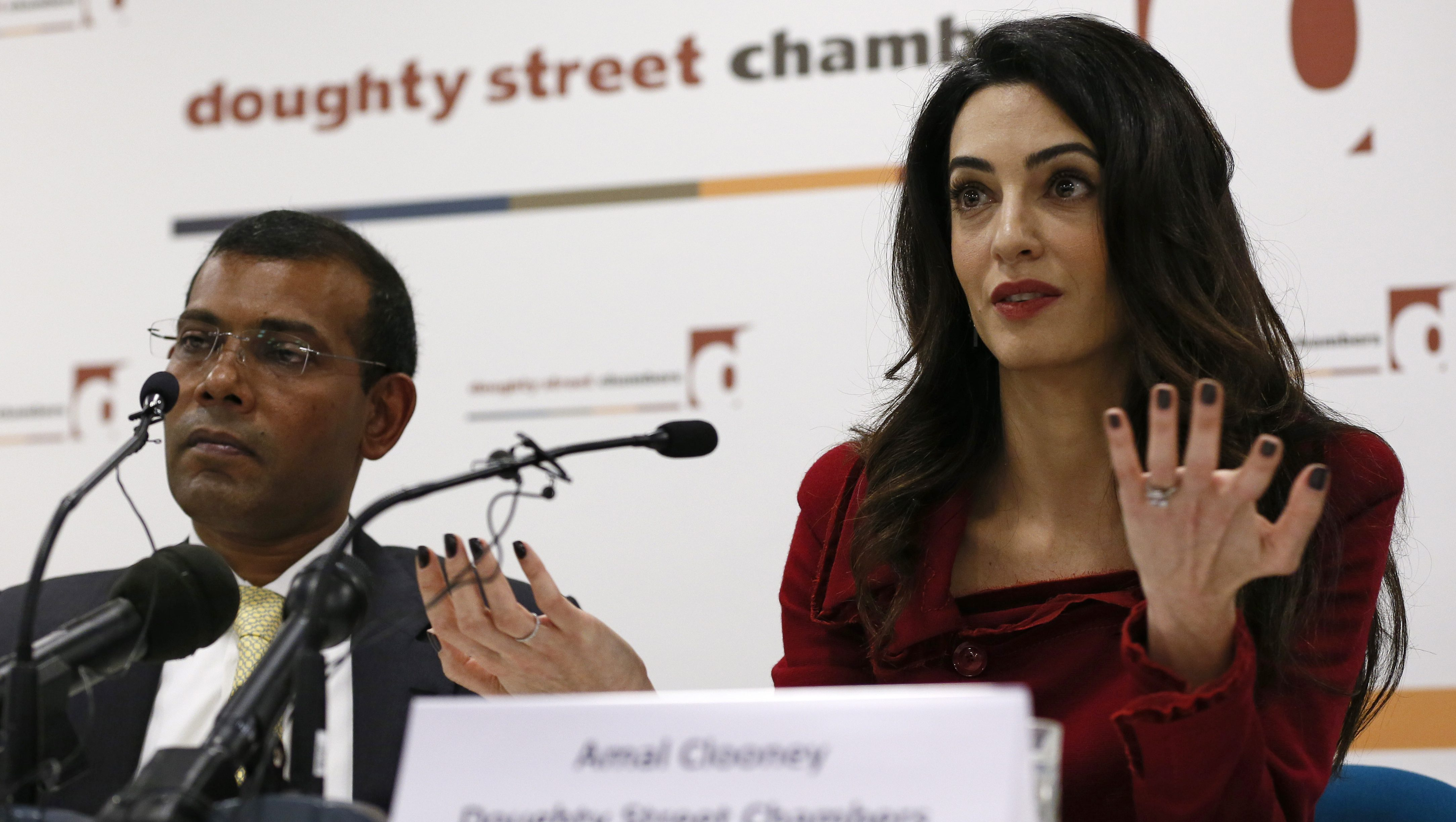 Lawyer Amal Clooney sits with Mohamed Nasheed during a news conference in central London, Britain January 25, 2016. Former president of the Maldives, Nasheed, freed from jail last week to seek medical care in Britain, called on Monday for sanctions against Maldivian government figures as his lawyer warned a militant attack on tourists was highly likely.
