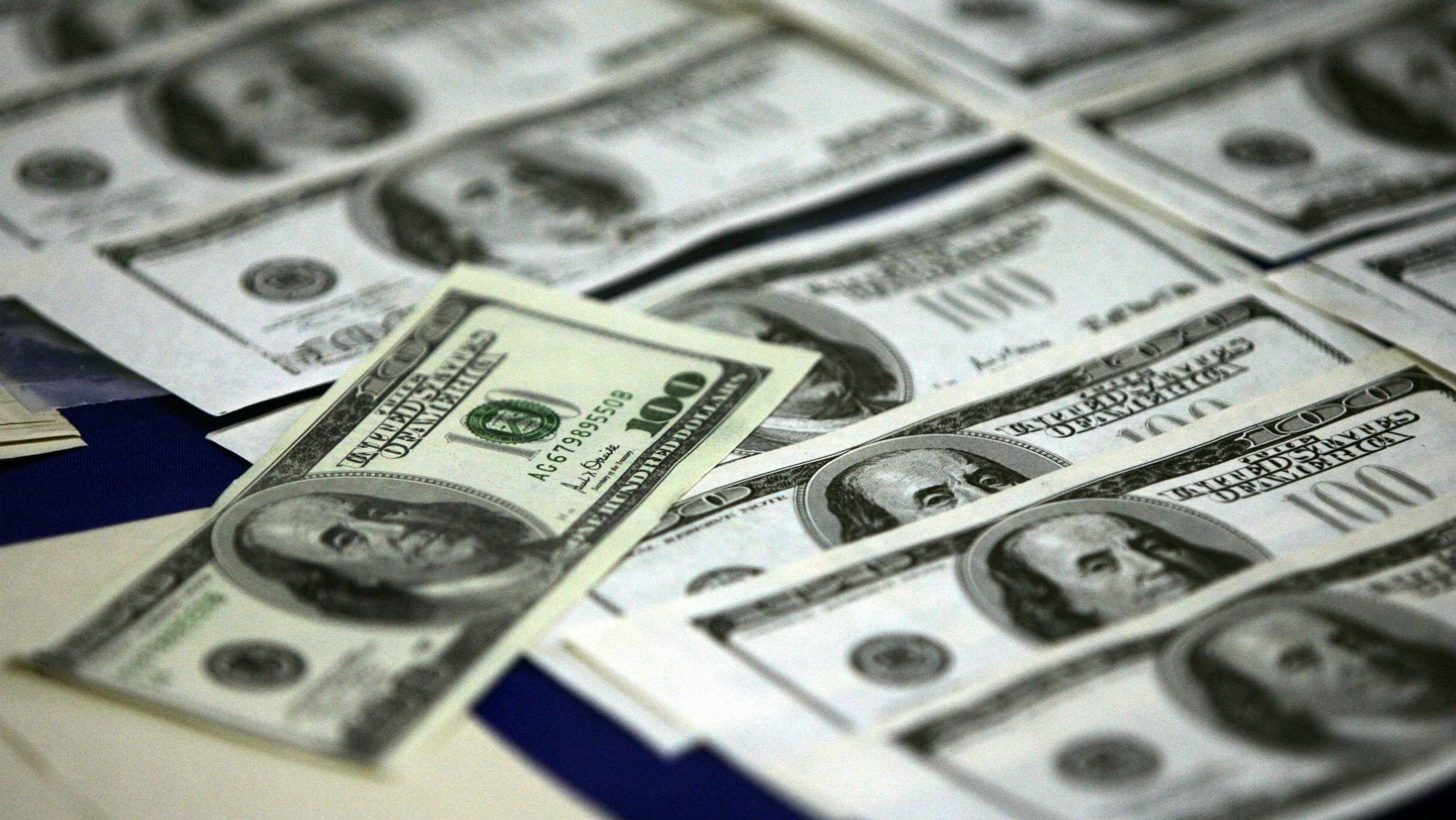One-hundred dollar bills.