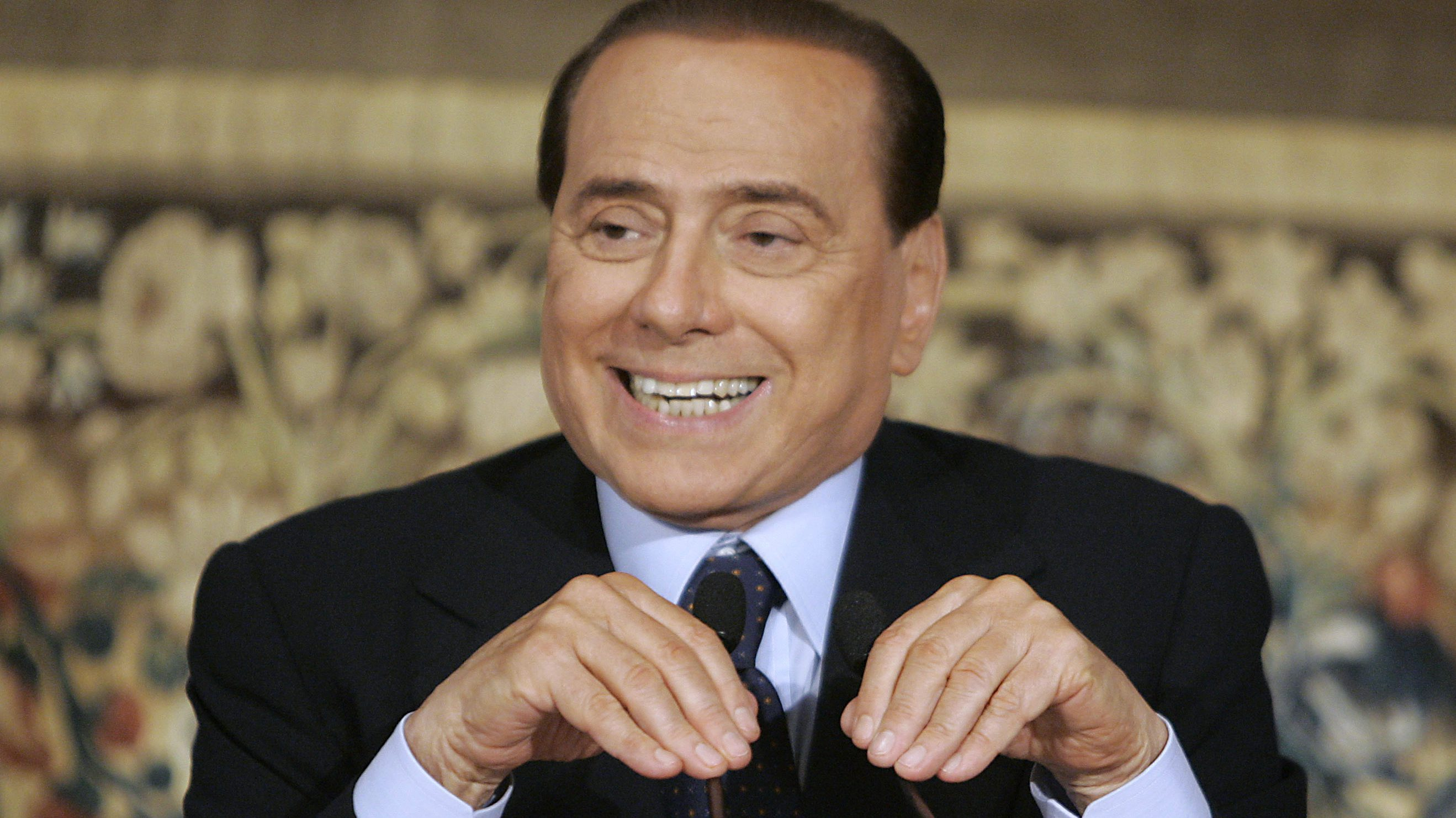 Italian Premier Silvio Berlusconi reacts during a press conference at Palazzo Chigi, premier's office, in Rome, Friday, Aug. 7, 2009. Berlusconi made one his strongest denials yet in a scandal over alleged relationships with young women, insisting on Friday he has nothing to hid and nothing to apologize for. (AP Photo/Pier Paolo Cito)