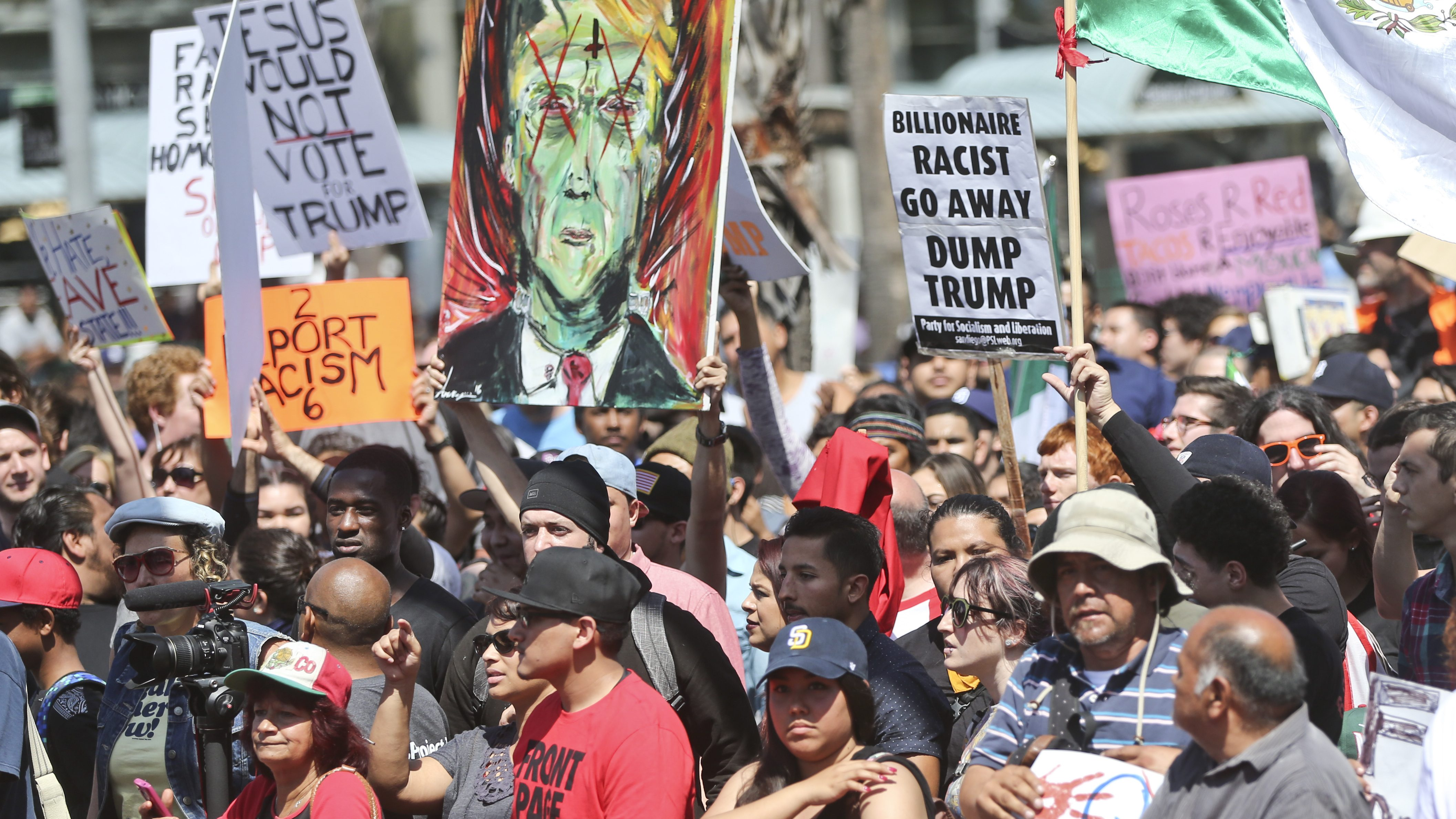 A crowd of anti-Trump demonstrators gather in front of the San Diego Convention Center.