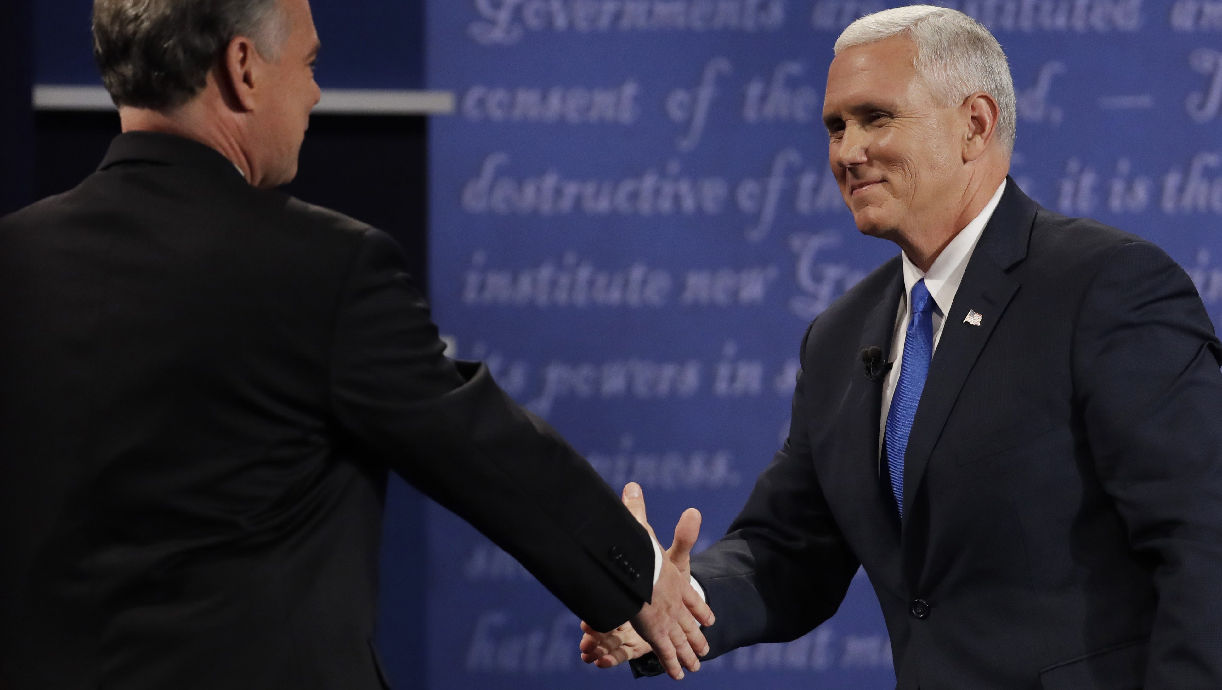 Republican vice-presidential nominee Gov. Mike Pence shake hands with Democratic vice-presidential nominee Sen. Tim Kaine during the vice-presidential debate at Longwood University in Farmville, Va., Tuesday, Oct. 4, 2016. (AP Photo/Patrick Semansky)