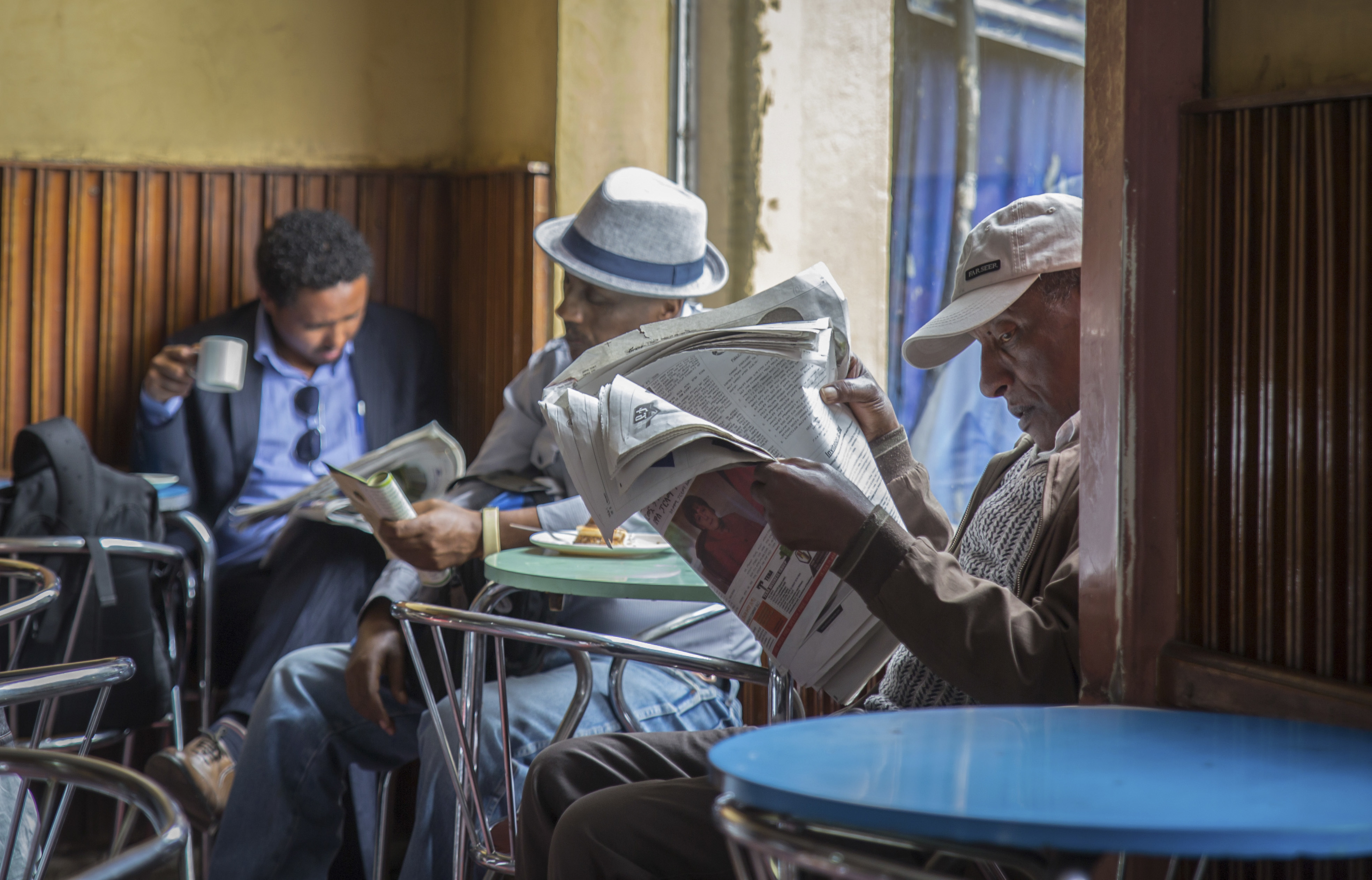 Reading the newspapers in Addis Ababa, Ethiopia.