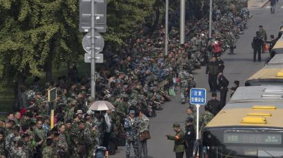Chinese military veterans protest outside the defense ministry in Beijing