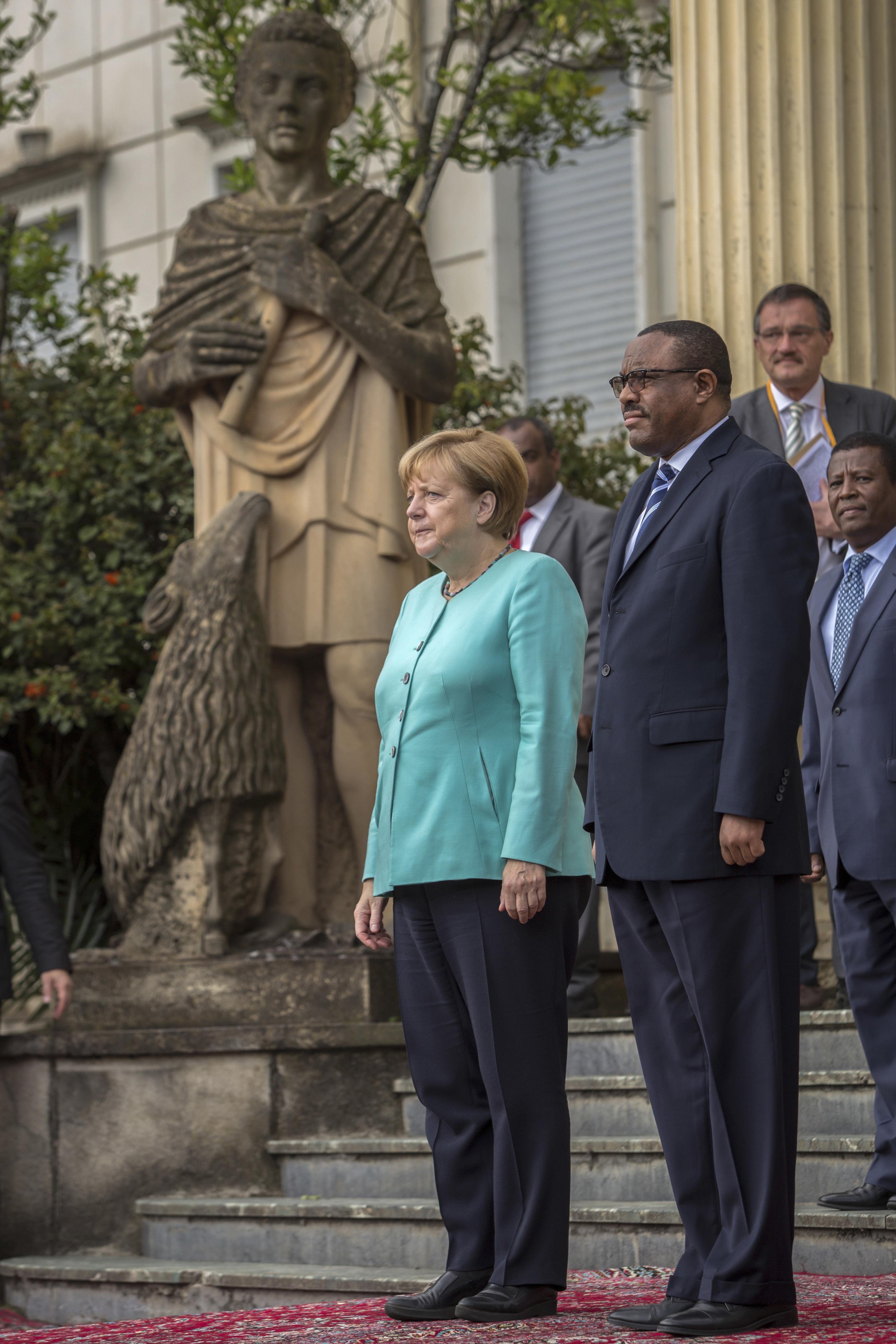 German Chancellor Angela Merkel, center, and Ethiopia's Prime Minister Hailemariam Desalegn.