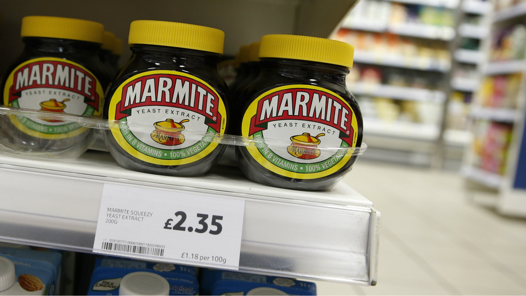 Jars of savoury spread 'Marmite' which is owned by the Anglo-Dutch multinational Unilever, on sale in a branch of Tesco in central London.