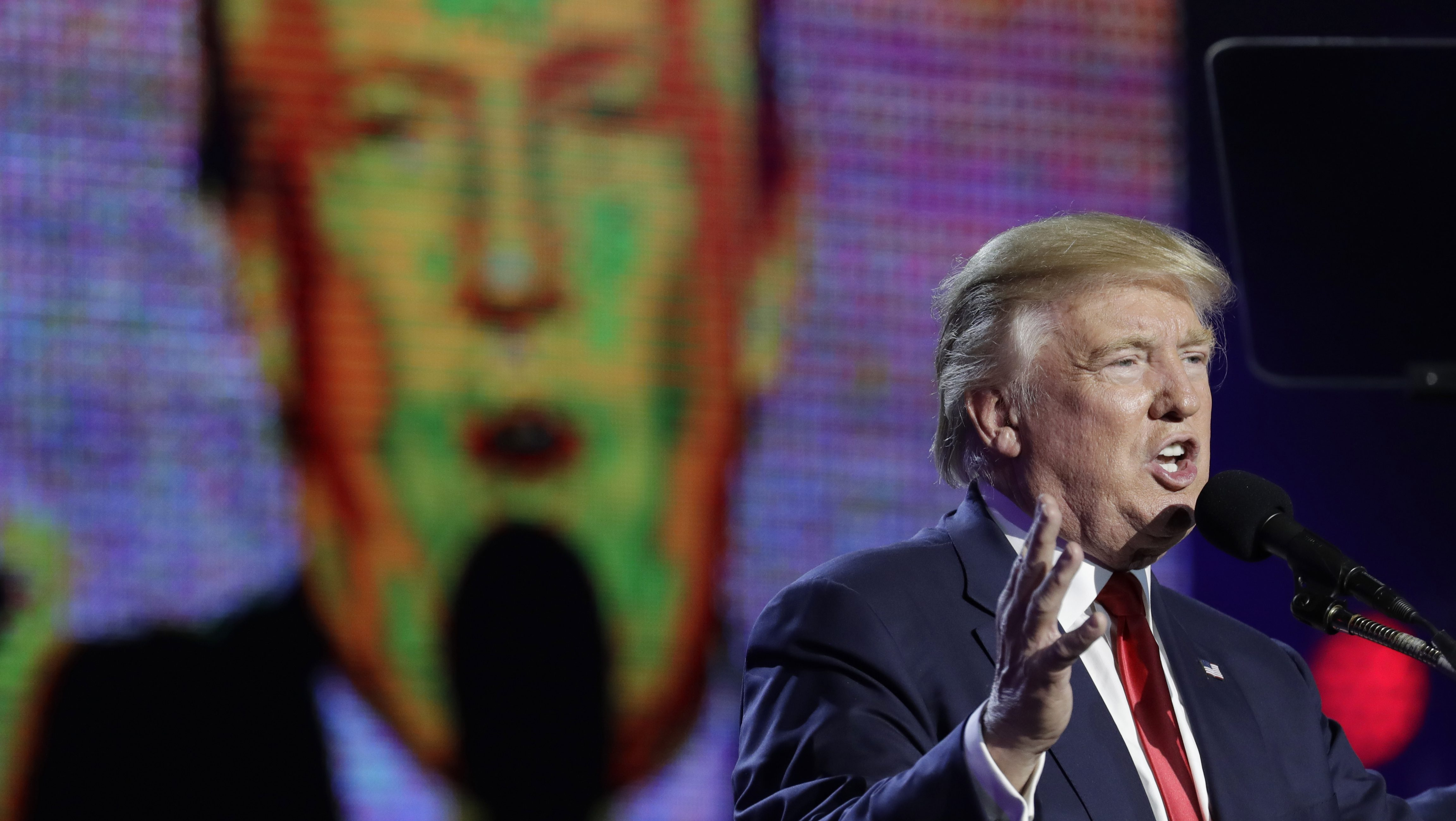 Republican presidential candidate Donald Trump is seen on a large screen as he speaks during a charity event hosted by the Republican Hindu Coalition, Saturday, Oct. 15, 2016, in Edison, N.J. (AP Photo/Julio Cortez)