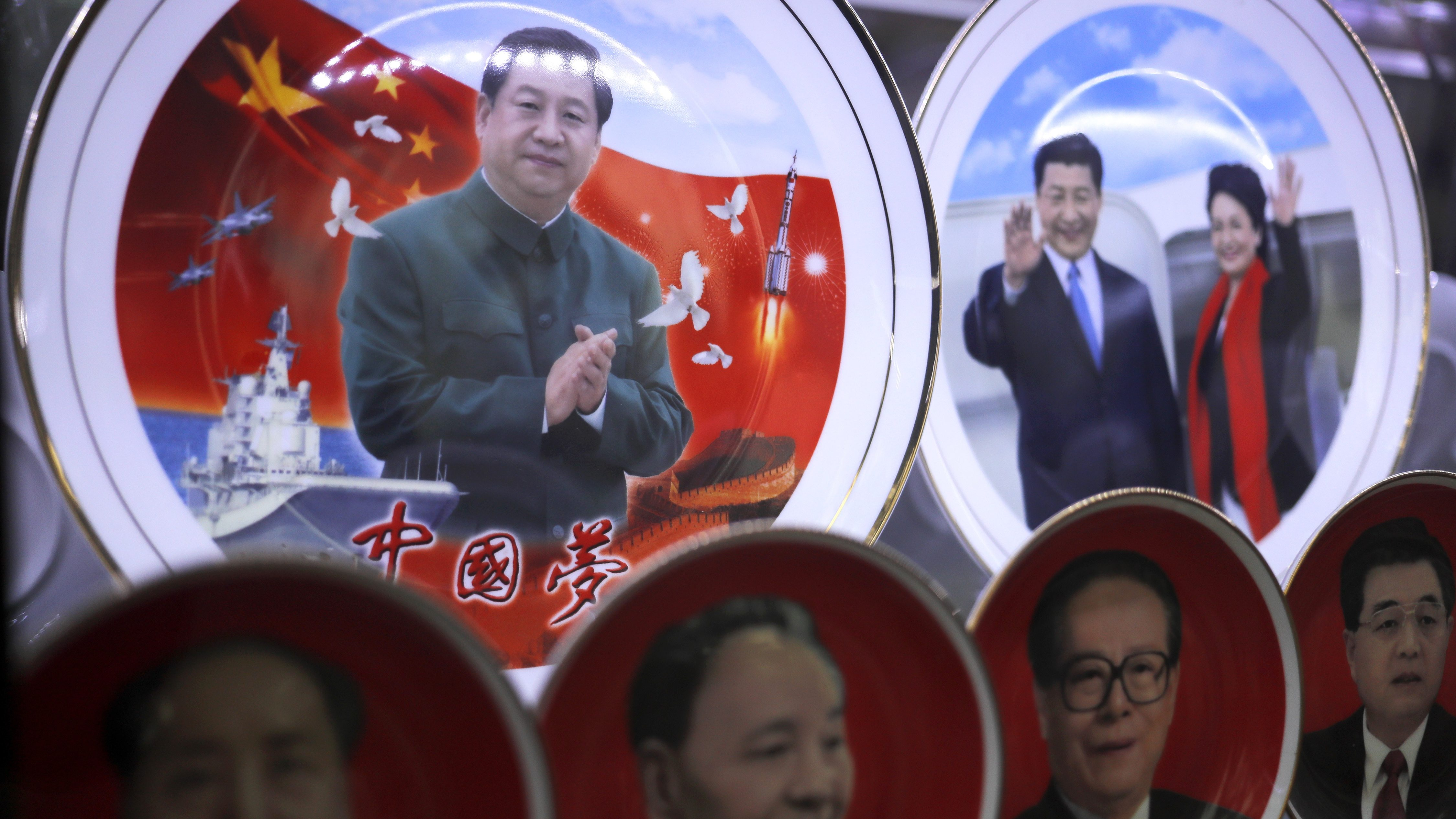 Porcelain plates baring images of Chinese President Xi Jinping and his wife Peng Liyuan are displayed with previous Chinese leaders below, from left, Mao Zedong, Deng Xiaoping, Jiang Zemin and Hu Jintao, at a souvenir shop near Tiananmen Square in Beijing, Thursday, Oct. 27, 2016. China's ruling Communist Party concludes a key meeting this week aimed at shoring up internal discipline and asserting General Secretary Xi's authority. The gathering is also expected to lay the groundwork for next year's national congress that will decide major leadership positions and lay out the agenda for Xi's next five-year term.