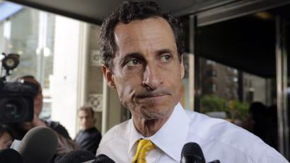 FILE - In this July 24, 2013 file photo, former New York Rep. Anthony Weiner leaves his apartment building in New York. The FBI informed Congress on Friday, Oct. 28, 2016, it is investigating whether there is classified information in new emails that have emerged in its probe of Hillary Clinton's private server. A U.S. official told The Associated Press the newly discovered emails emerged through the FBI's separate sexting probe of former congressman Anthony Weiner, the estranged husband of close Clinton confidant Huma Abedin. (AP Photo/Richard Drew, File)