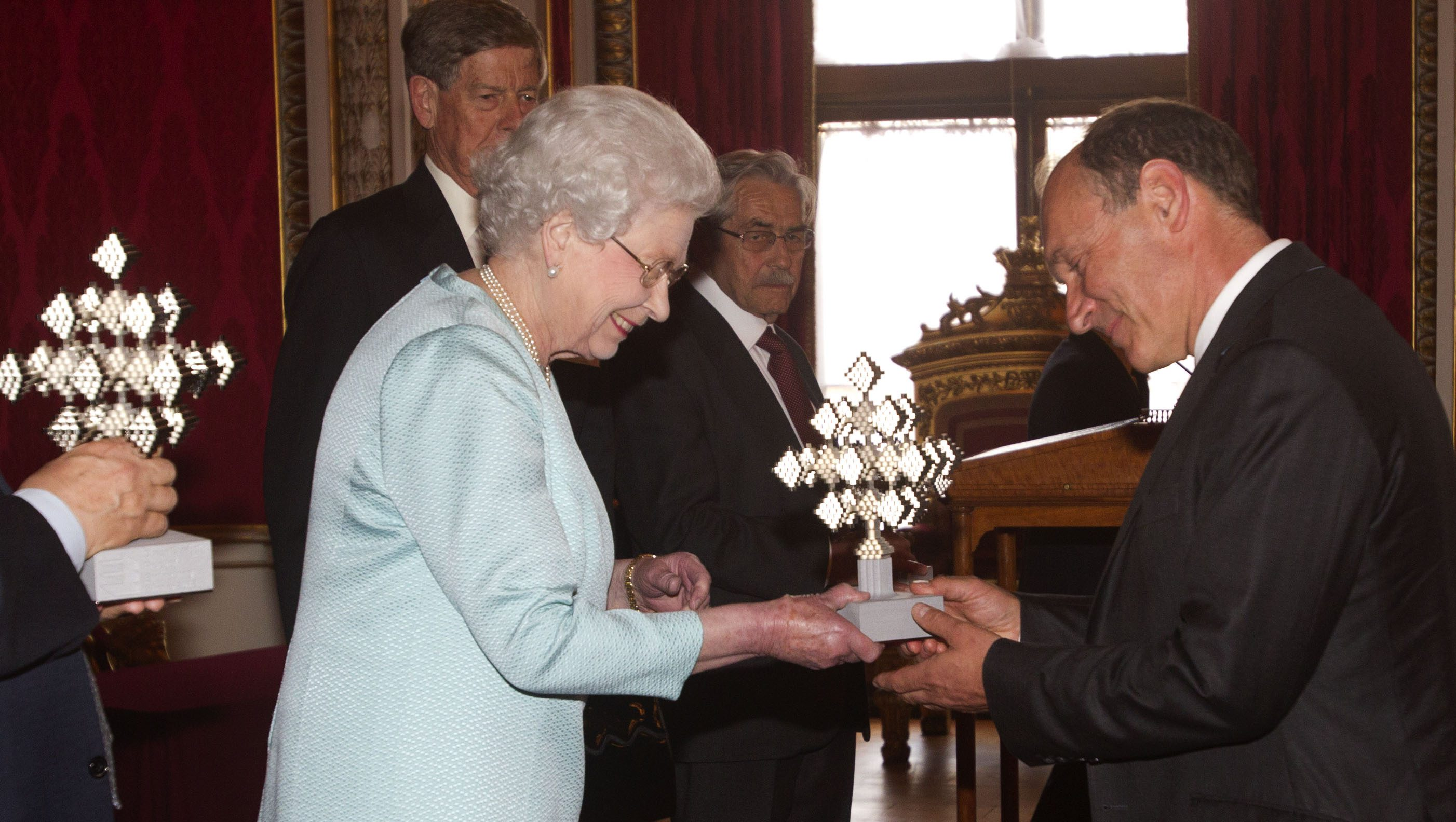 Tim Berners-Lee, a British computer scientist best known as the inventor of the World Wide Web,  receives the inaugural Queen Elizabeth Prize for Engineering, awarded jointly with Louis Pouzin, Robert Kahn, Vint Cerf, and  Marc Andreessen,  from Queen Elizabeth II at a reception at Buckingham Palace, London, Tuesday June 25, 2013. The one million pound ($1.54 million) award is a global engineering prize that rewards and celebrates individual  or team  responsible for a ground-breaking innovation in engineering which has been of global benefit to humanity (AP Photo/ Lewis Whyld, Pool)