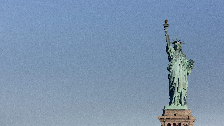 The Statue of Liberty overlooks New York Harbor, Thursday, Sept. 15, 2016. (AP Photo/Mark Lennihan)