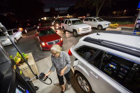 Gayle Brown fills up her car after waiting in line at a Sunoco gas station in Mt. Pleasant, S.C. on Oct, 4, 2016 in advance of Hurricane Matthew which is expected to affect the South Carolina coast by the weekend. Gov. Nikki Haley announced Tuesday that, unless the track of the storm changes, the state will issue an evacuation order Wednesday to help get 1 million people inland from the coast.