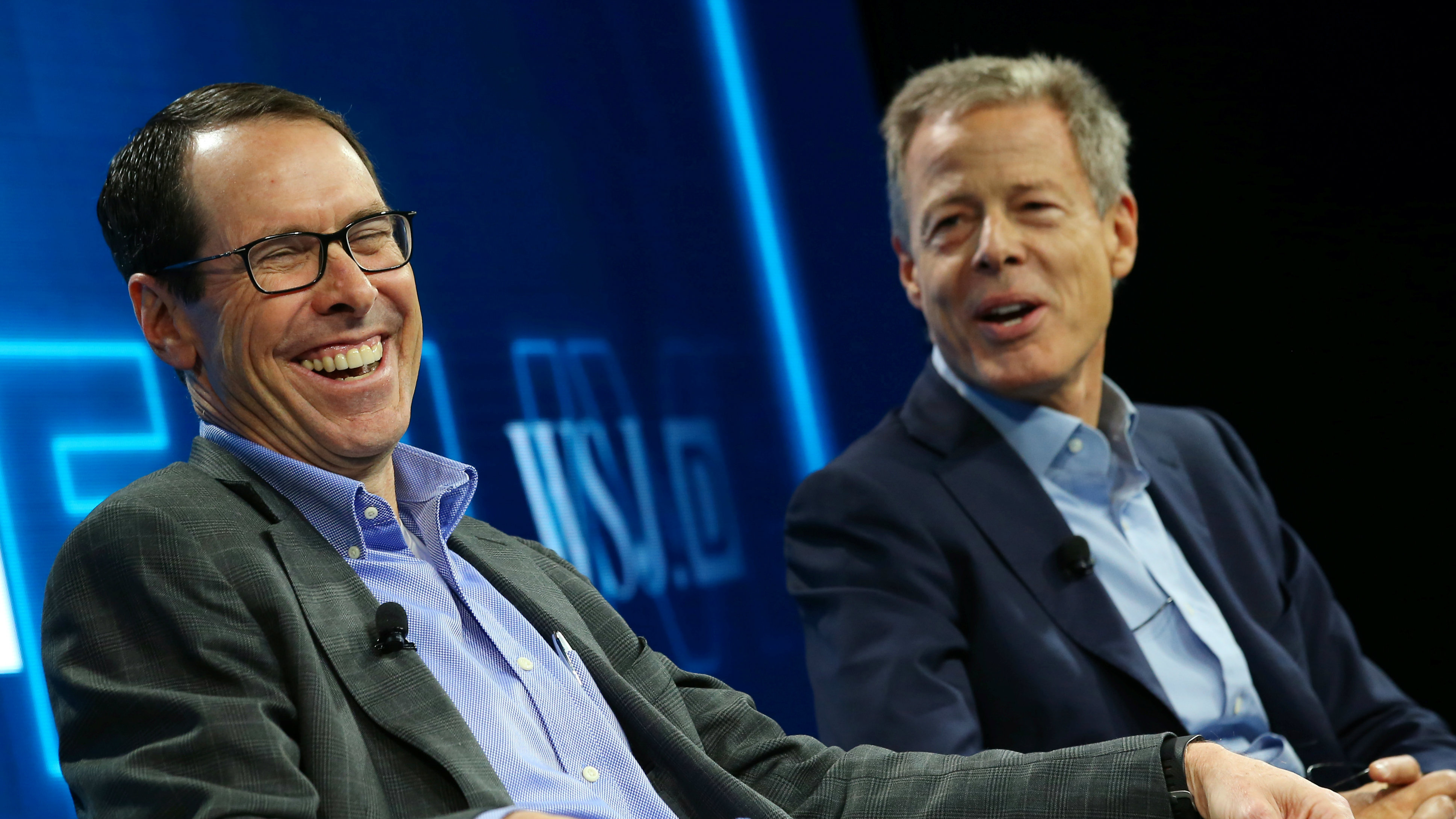 AT&T CEO Randall Stephenson shares a laugh with Time Warner Inc CEO Jeff Bewkes as they discuss their proposed merger at the WSJD Live conference in Laguna Beach, California, U.S., October 25, 2016. REUTERS/Mike Blake