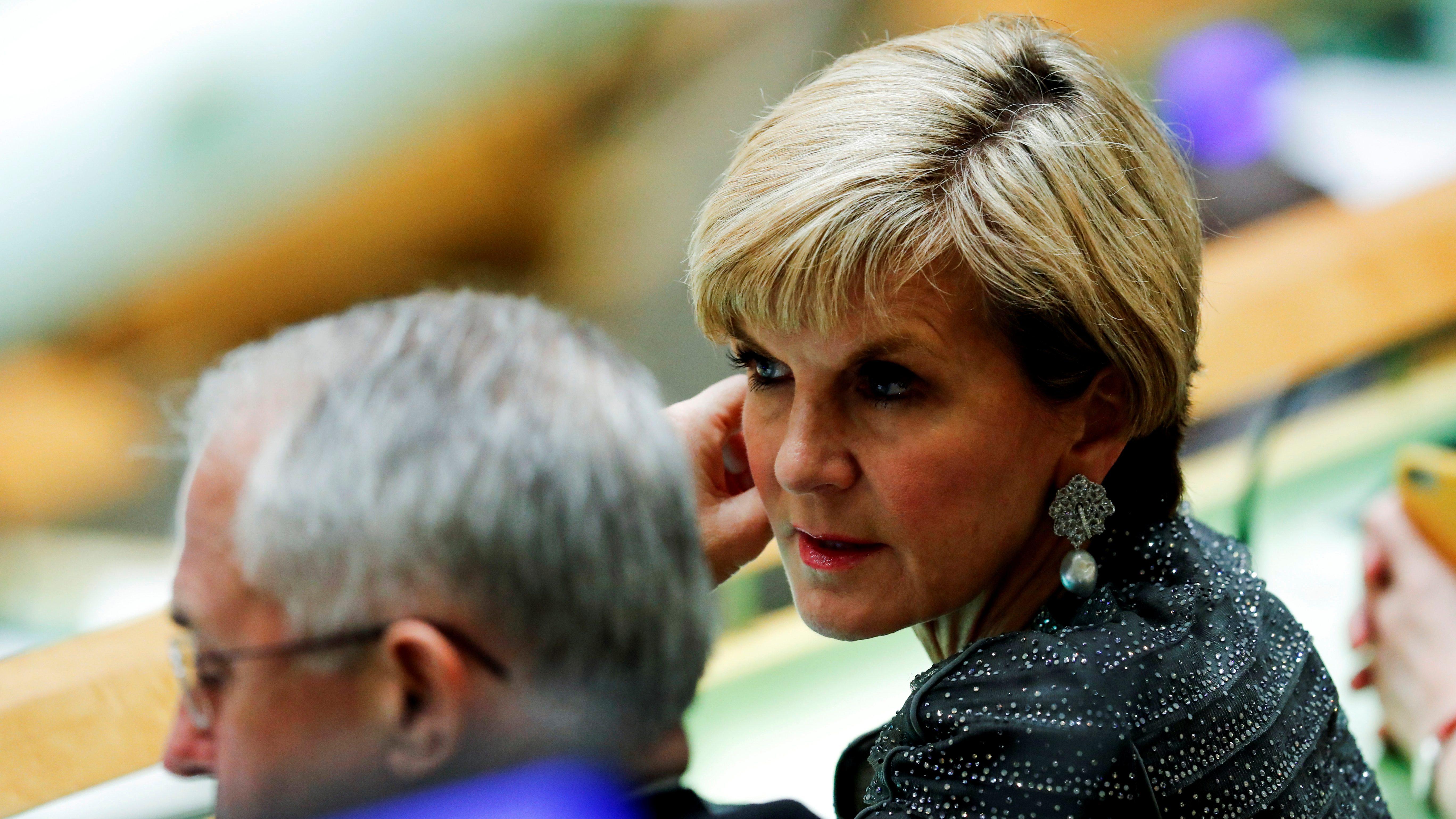 Australia's Foreign Minister Julie Bishop speaks to Australia's Prime Minister Malcolm Turnbull