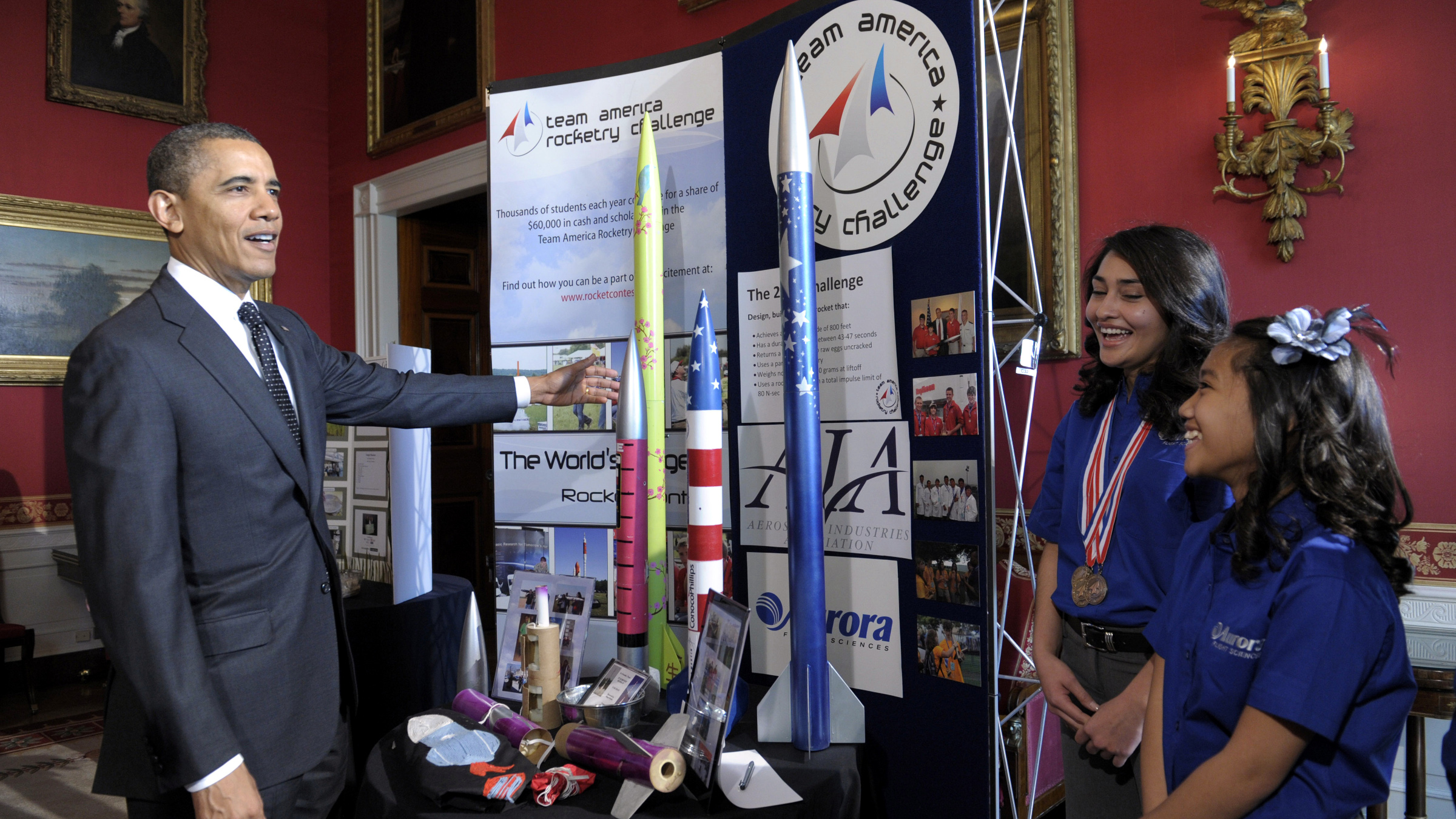President Barack Obama talks with Janet Nieto, second from right, Gwynelle Condino, right, both from Presidio, Texas, in the State Dining Room of the White House in Washington, Tuesday, Feb. 7, 2012, for the White House Science Fair. Both girls have successfully competed in a number of rocketry challenges and have attended the NASA Student Launch Initiative Advanced Rocketry program. Obama hosted the second White House Science Fair celebrating the student winners of a broad range of science, technology, engineering and math (STEM) competitions from across the country.