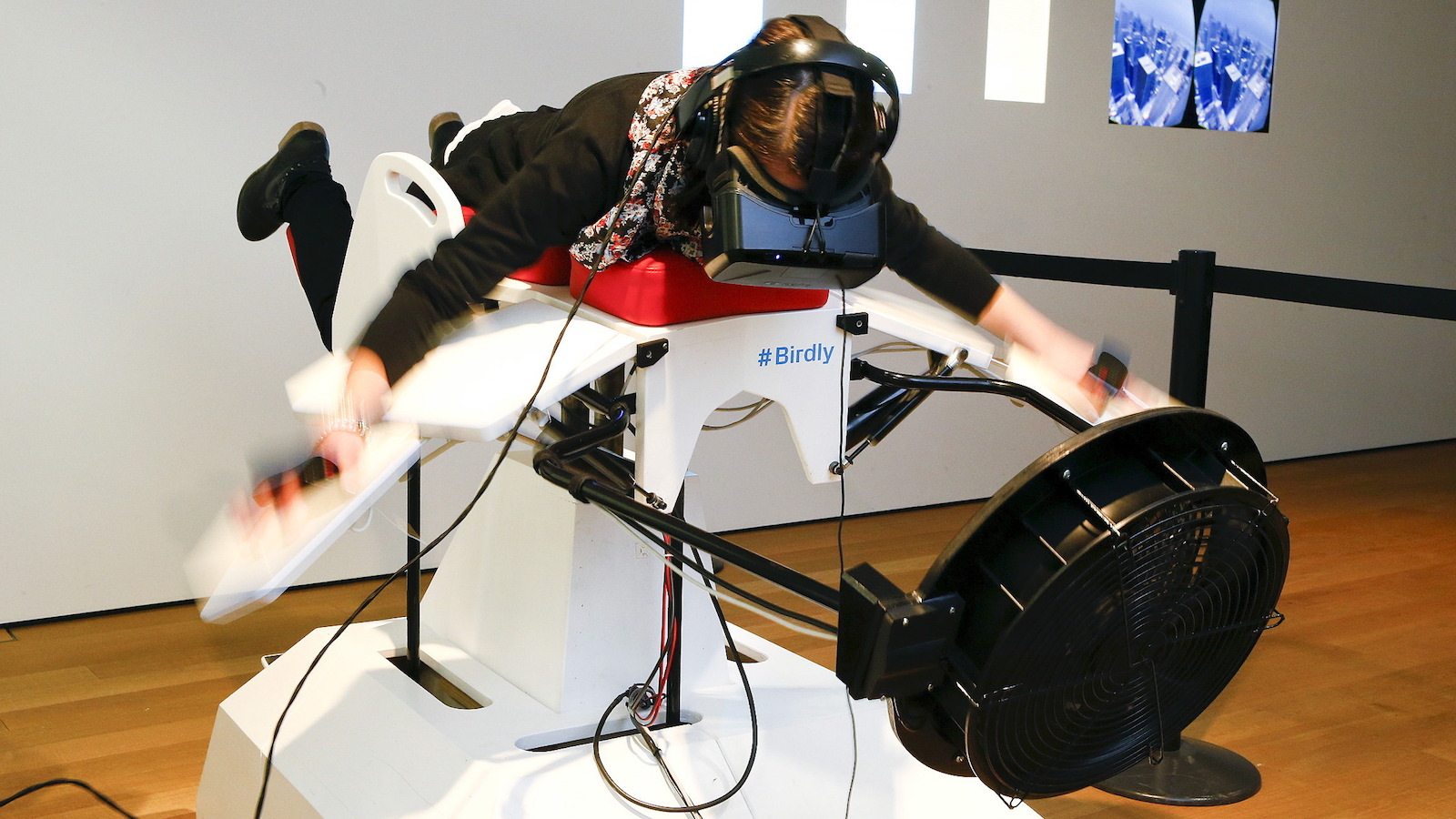 """A visitor tries the flight simulator Birdly at the exhibition """"Animated Wonderworlds"""" at Museum fuer Gestaltung (Museum for Design) in Zurich, November 17, 2015. Birdly simulates the flight of a red kite over New York City, controlled by the entire body of the user. The flight simulator was developed by scientists at Zurich University of the Arts. REUTERS/Arnd Wiegmann  - RTS7JXB"""