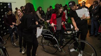 A BuzzBike employee handing over a cycle to a user at a Shoreditch launch event