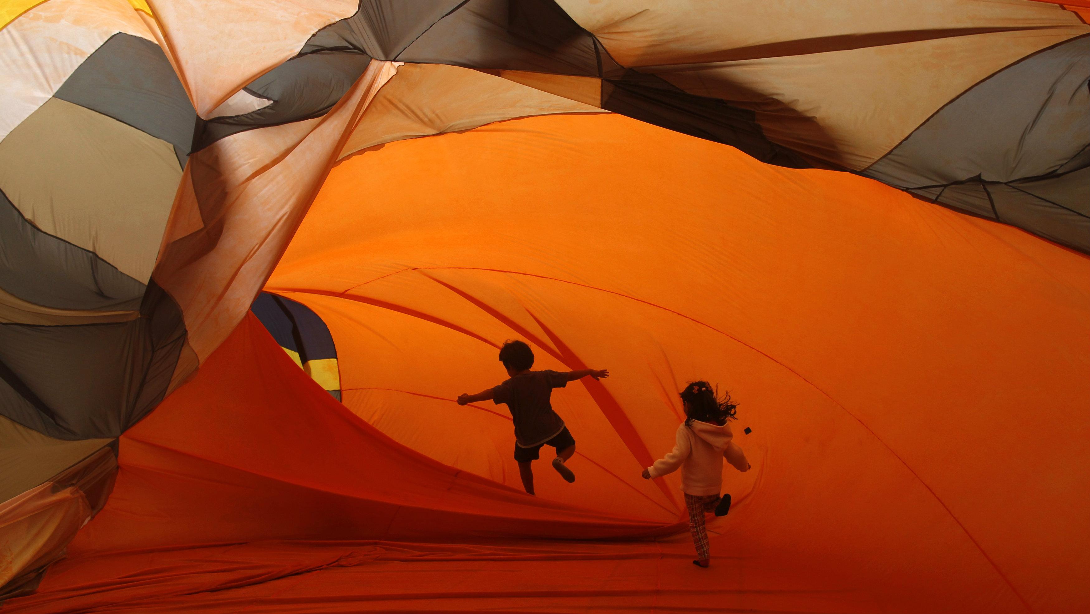 Children play inside inflatable installations at the Casa Daros museum in Rio de Janeiro September 29, 2013. REUTERS/Pilar Olivares