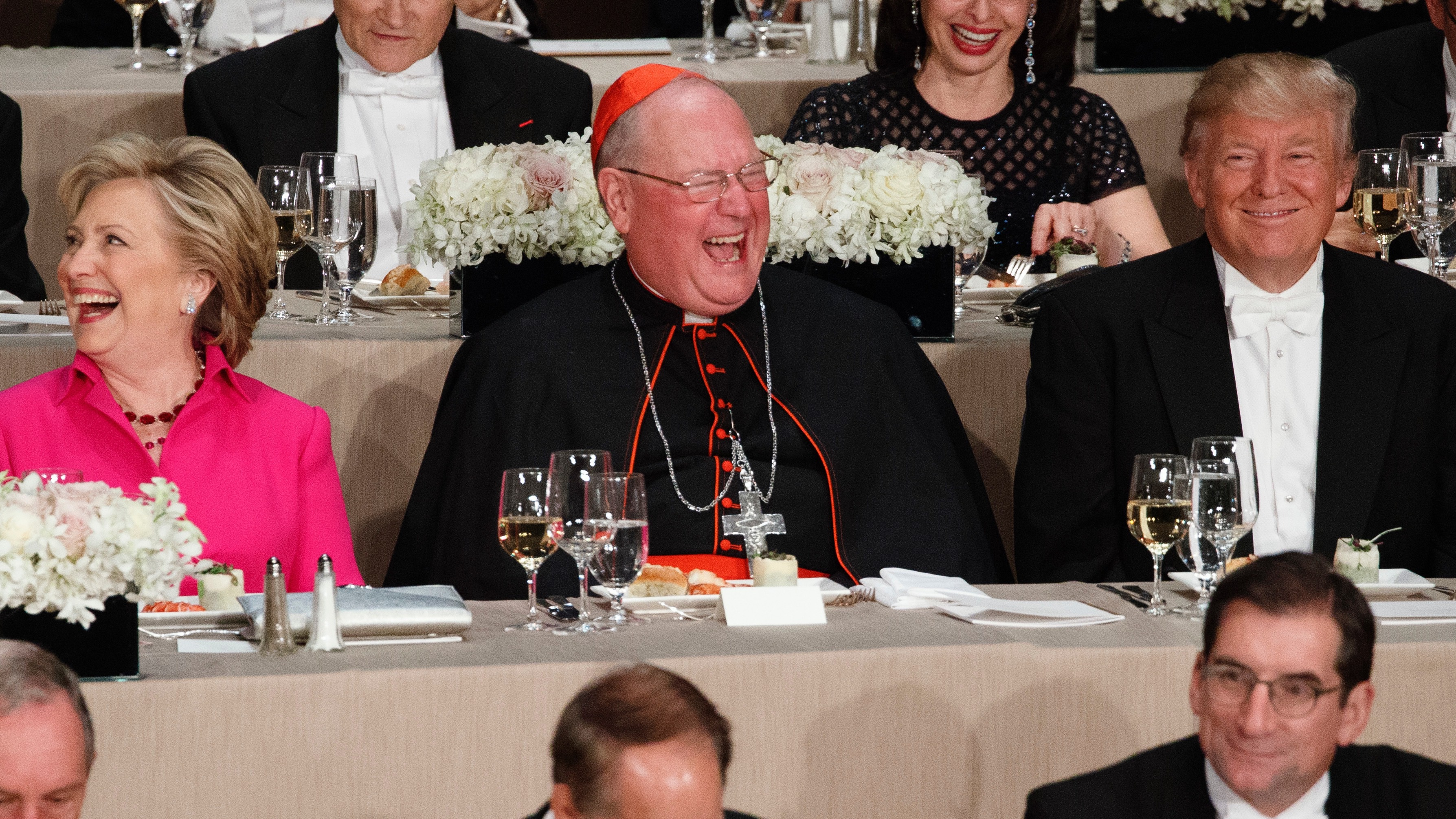 Republican presidential candidate Donald Trump, right, laughs at a joke with Cardinal Timothy Dolan, center, and Democratic presidential candidate Hillary Clinton during the Alfred E. Smith Memorial Foundation dinner, Thursday, Oct. 20, 2016, in New York. (AP Photo/ Evan Vucci)