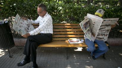 People read newspapers the day after the government signed a peace agreement with the FARC that address longstanding inequality.